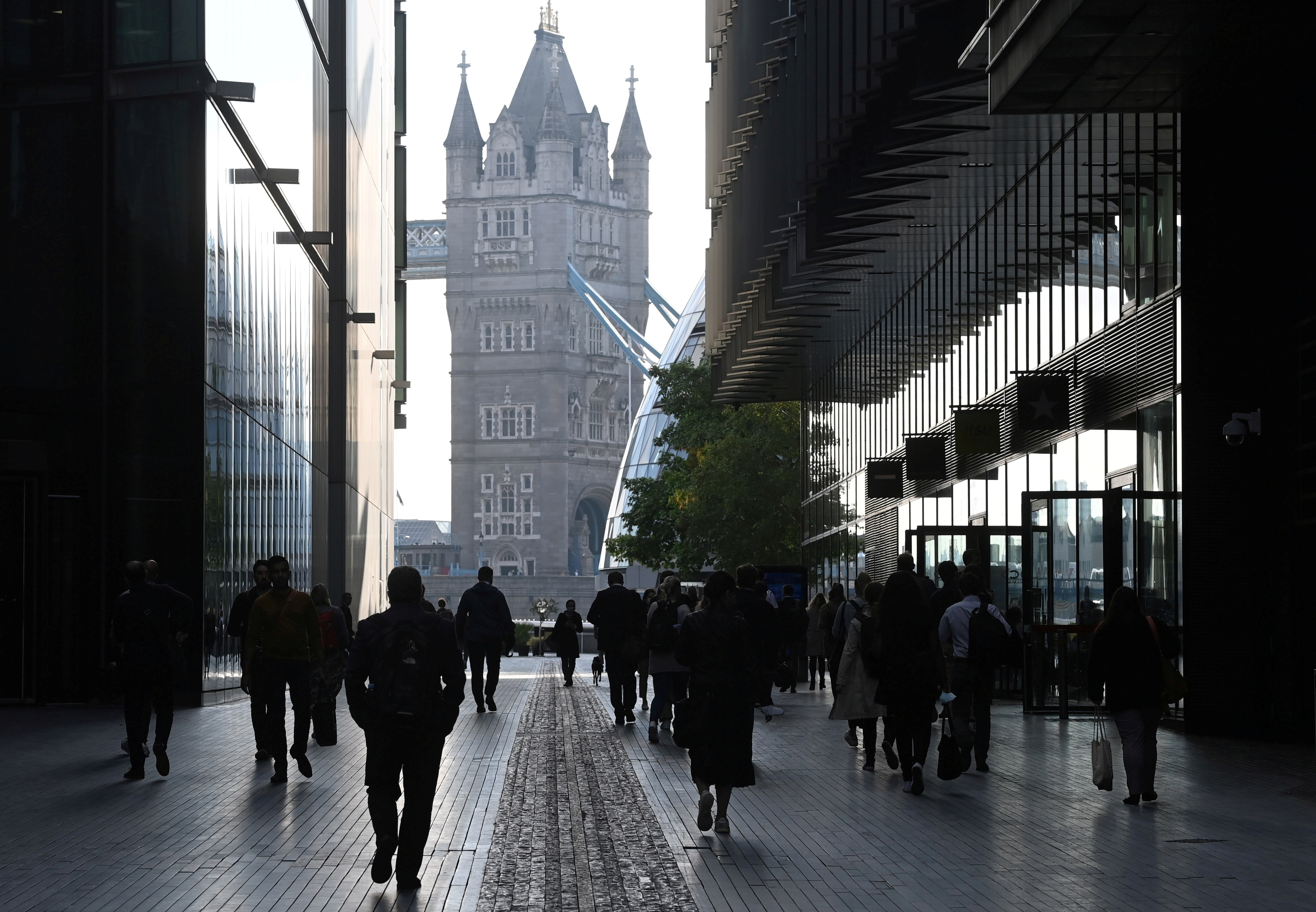 Workers walk towards Tower Bridge during the morning rush hour, amid a relaxation of lockdown restrictions during the coronavirus disease (COVID-19) pandemic in London, Britain, September 15, 2021. REUTERS/Toby Melville