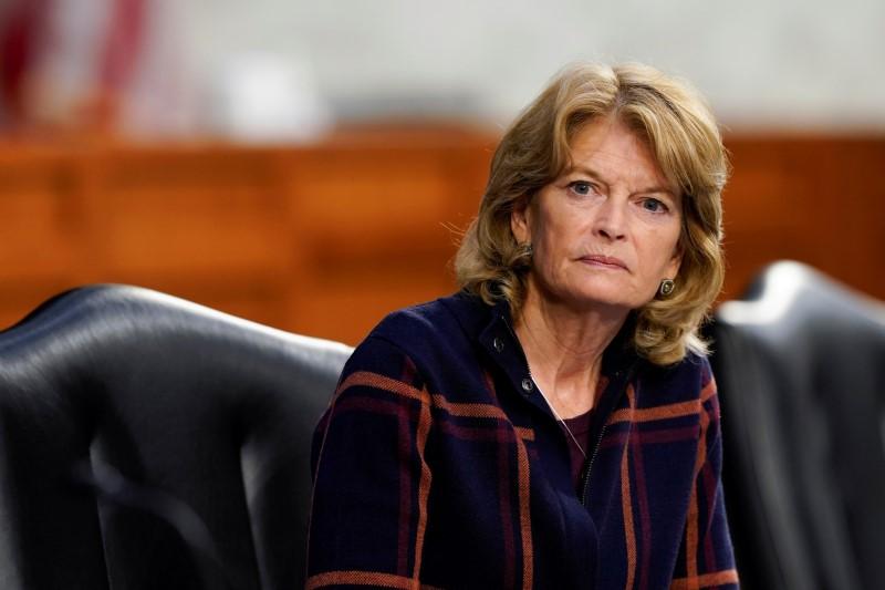 Sen. Lisa Murkowski, R-Alaska, listens during a U.S. Senate Health, Education, Labor and Pensions Committee hearing in Washington, U.S., March 18, 2021. Susan Walsh/Pool via REUTERS/File Photo