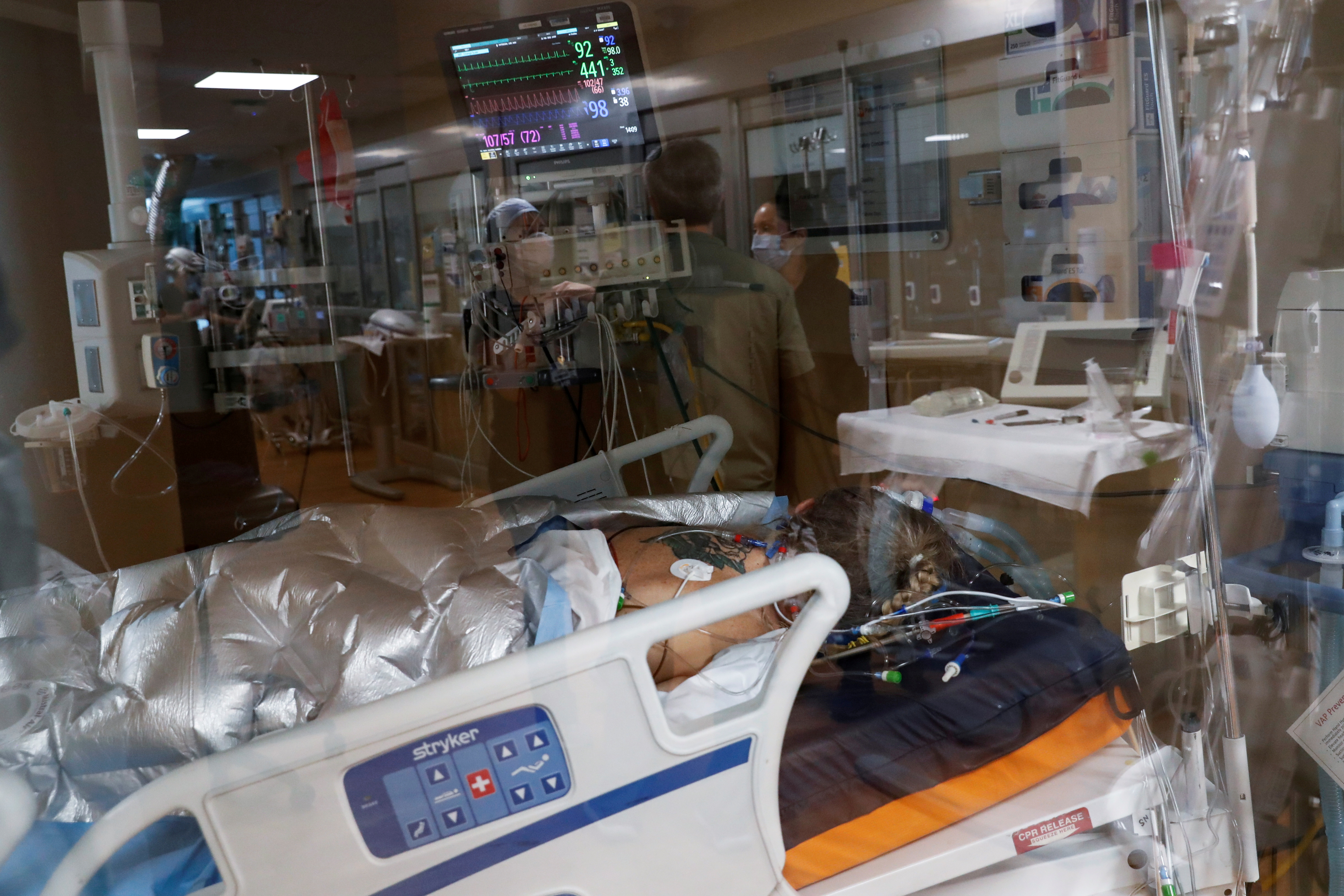 A coronavirus disease (COVID-19) positive patient lies in a bed in the intensive care unit (ICU) at Sarasota Memorial Hospital in Sarasota, Florida, February 11, 2021. REUTERS/Shannon Stapleton/File Photo