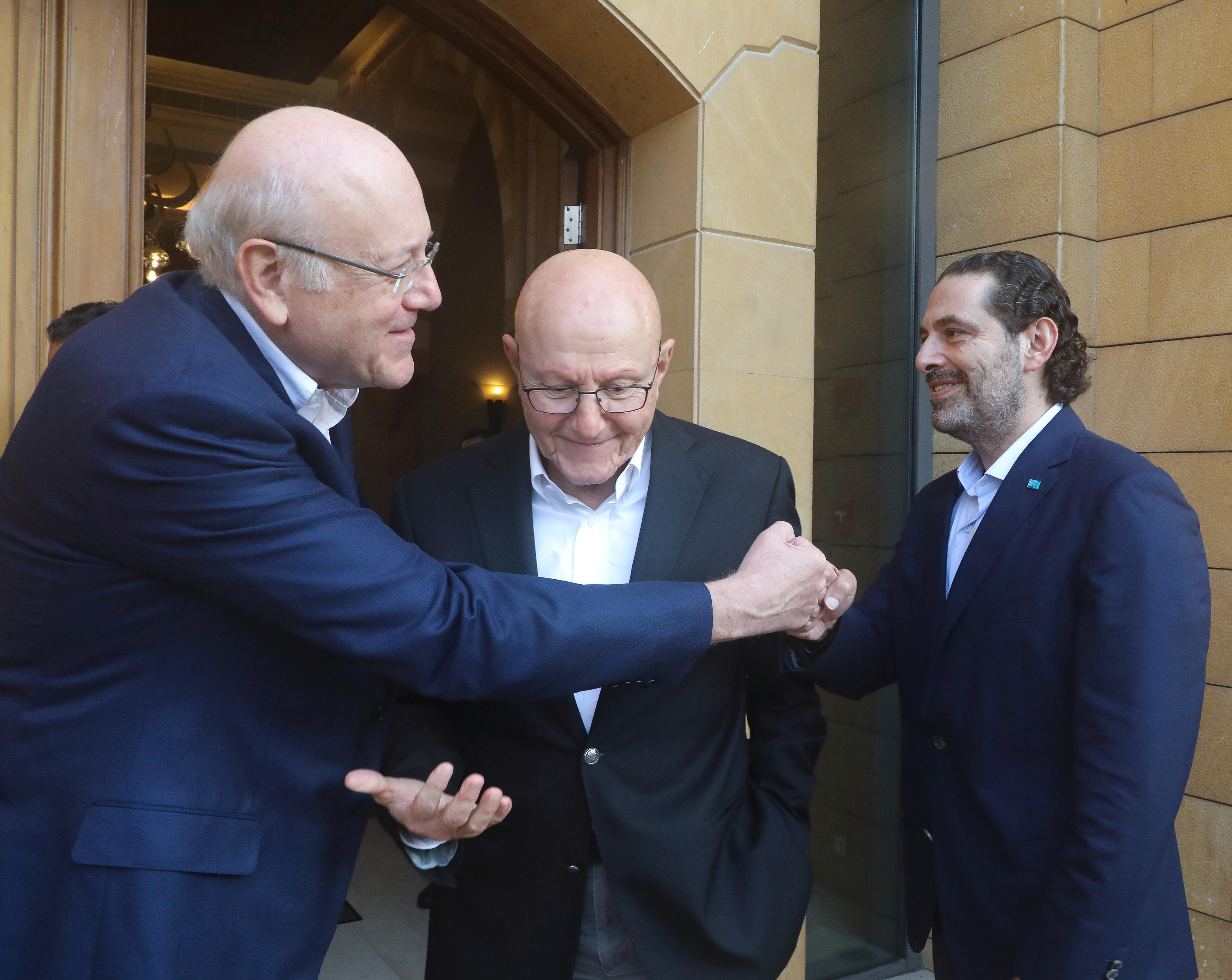 Lebanese former prime ministers, Saad al-Hariri and Najib Mikati greet each other in Beirut, Lebanon July 25, 2021. Dalati Nohra/Handout via REUTERS