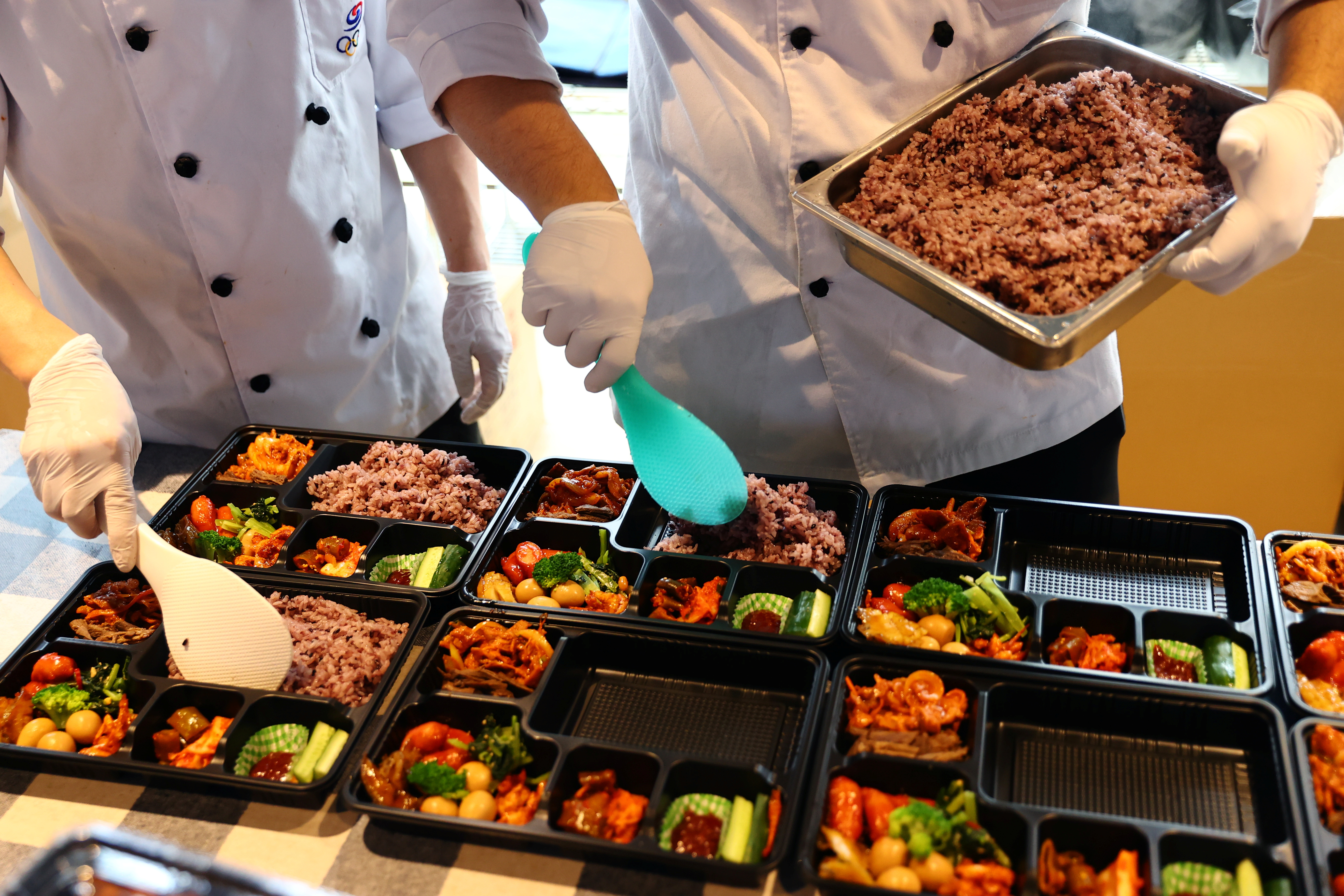 Chefs dispatched from South Korea prepare boxed meals for the country's Tokyo 2020 Olympic Games athletes at a hotel in Urayasu, Chiba Prefecture, Japan, July 26, 2021.   REUTERS/Kim Kyung-Hoon