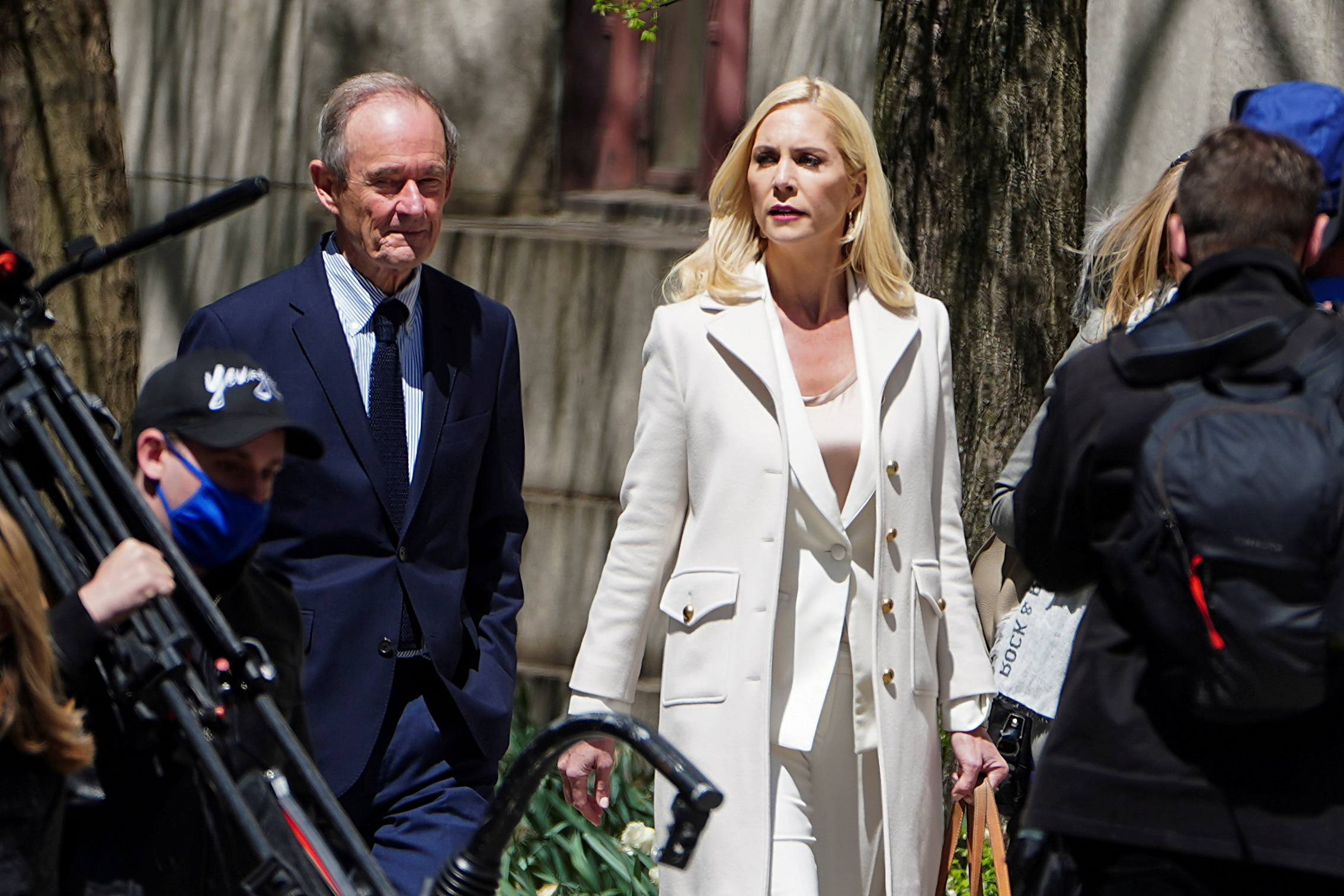 Lawyers David Boies and Sigrid McCawley arrive at Manhattan Federal Court ahead of Ghislaine Maxwell's arraignment on a new indictment, in the Manhattan borough of New York City, New York, U.S. April 23, 2021. REUTERS/Carlo Allegri