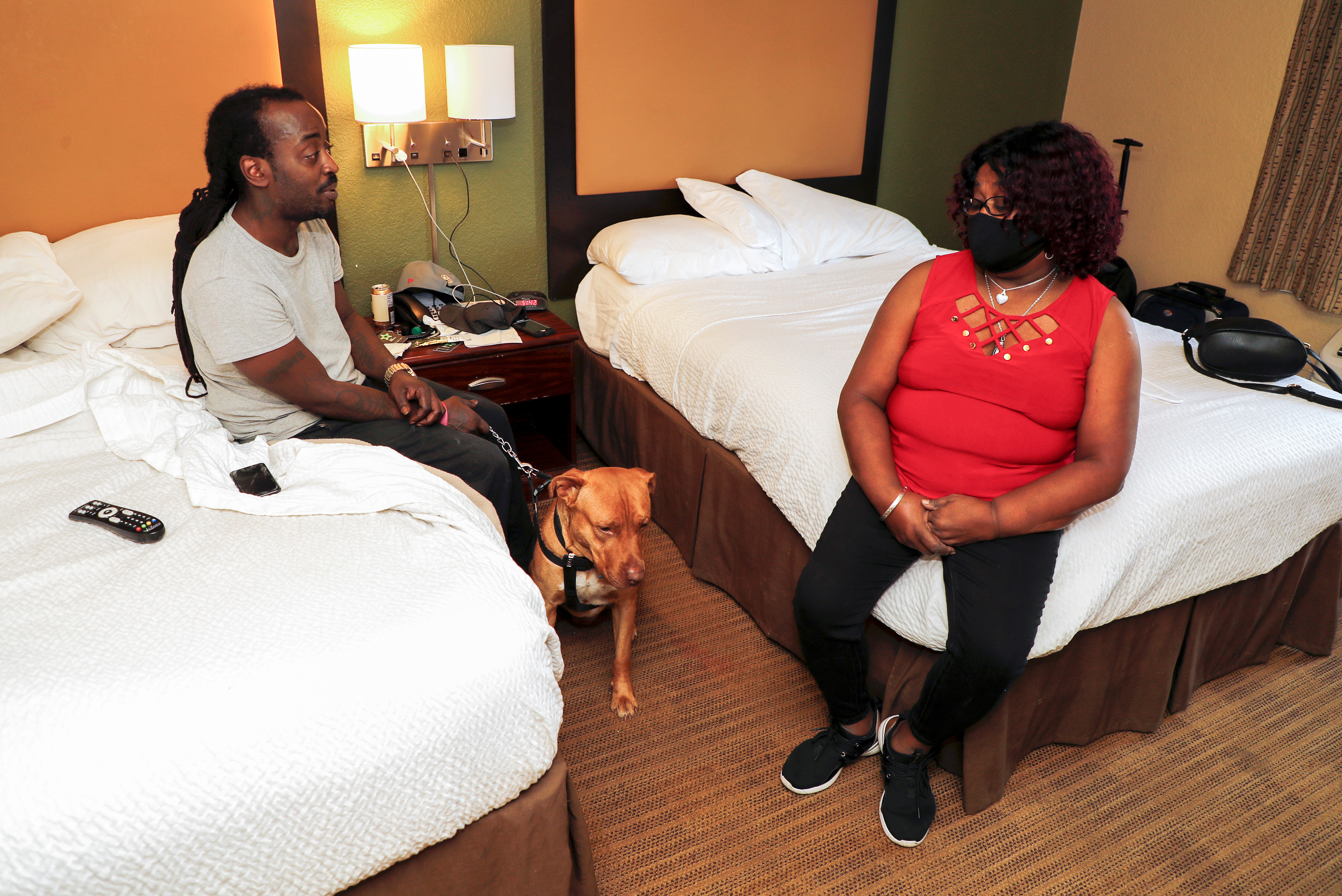 Greyhound Bus driver Marvia Robinson sits with her son Cecil Appleton Jr. and his dog 'Dutch