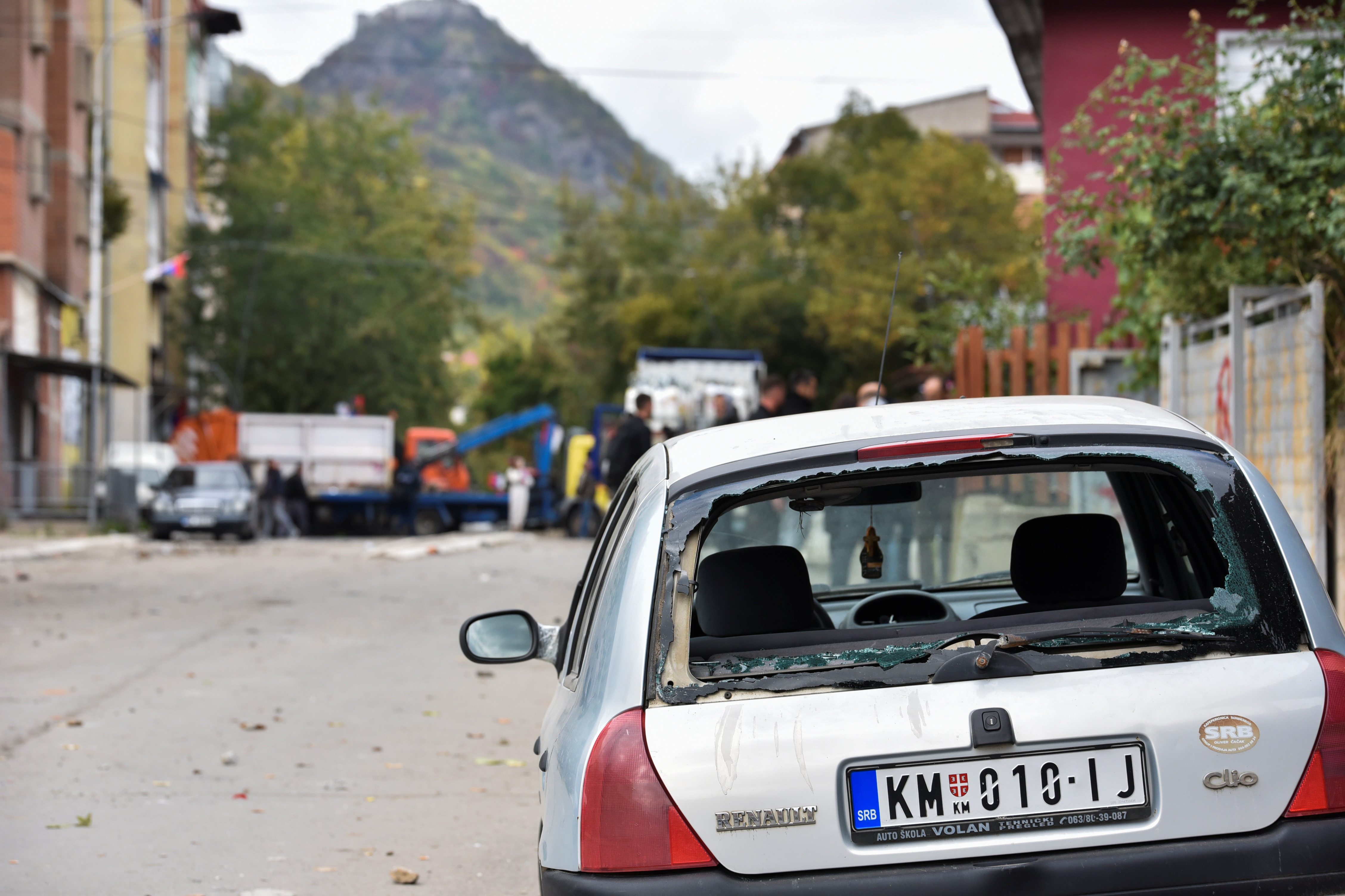 Damaged cars are pictured following clashes with ethnic Serbs during a police operation against the smuggling of goods, in Mitrovica, Kosovo, October 13, 2021. REUTERS/Laura Hasani