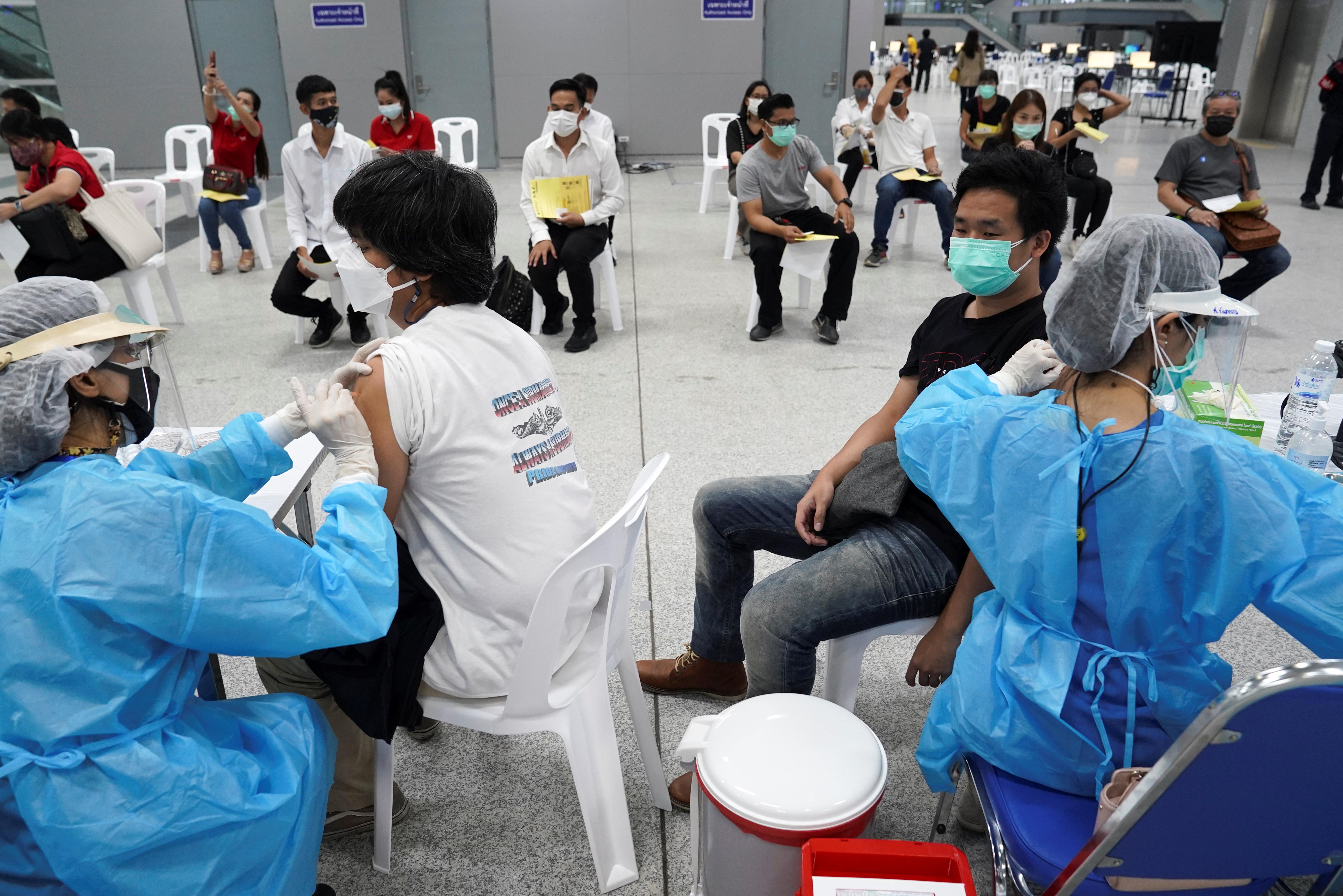 People receive China's Sinovac coronavirus disease (COVID-19) vaccine at the Central Vaccination Center, inside the Bang Sue Grand Station, in Bangkok, Thailand, May 24, 2021. REUTERS/Athit Perawongmetha