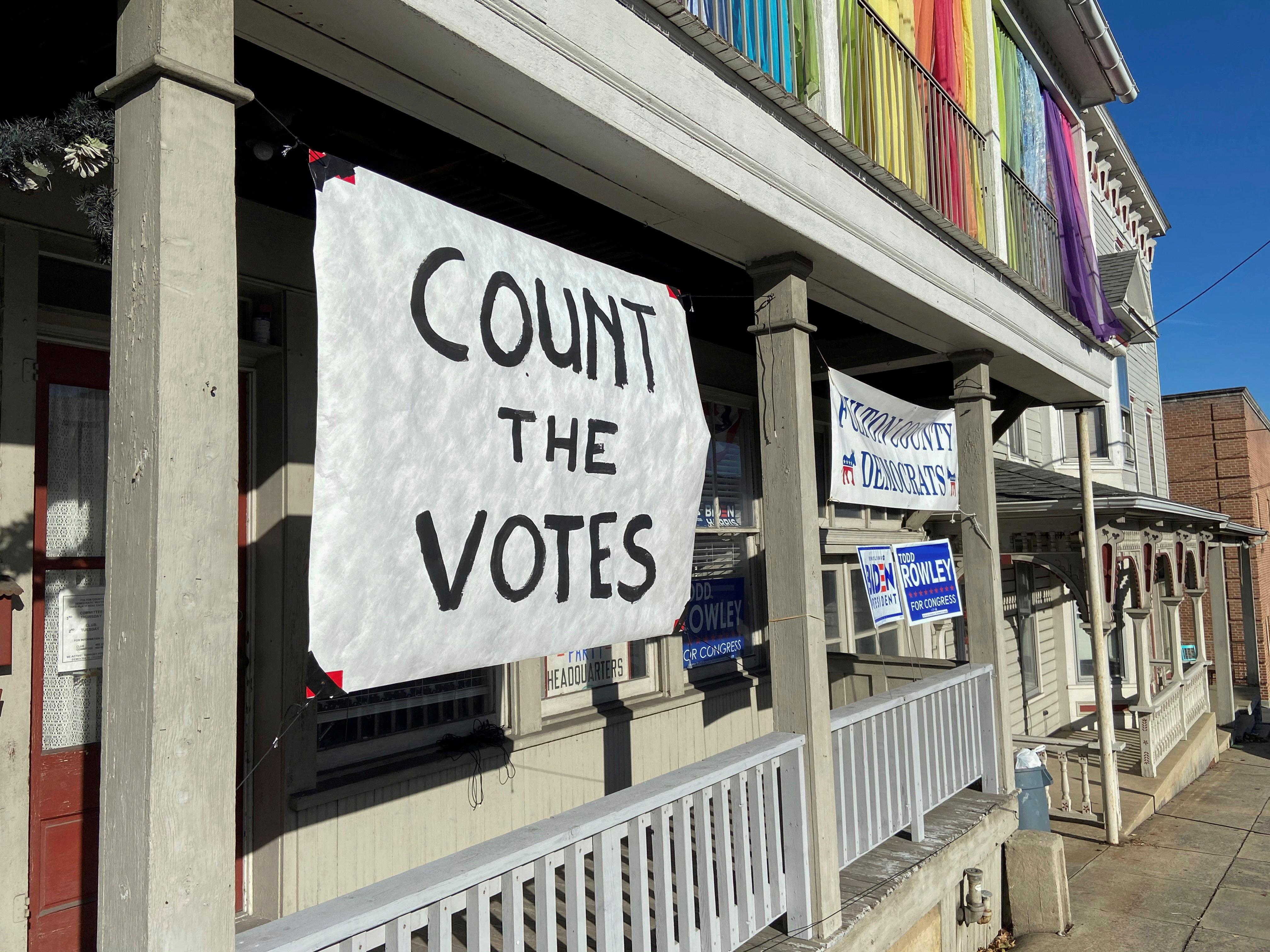 A sign urging people to vote is seen on the porch of the Democratic Party's Fulton County headquarters on Election Day in McConnellsburg, Pennsylvania November 3, 2020. REUTERS/Nathan Layne/File Photo