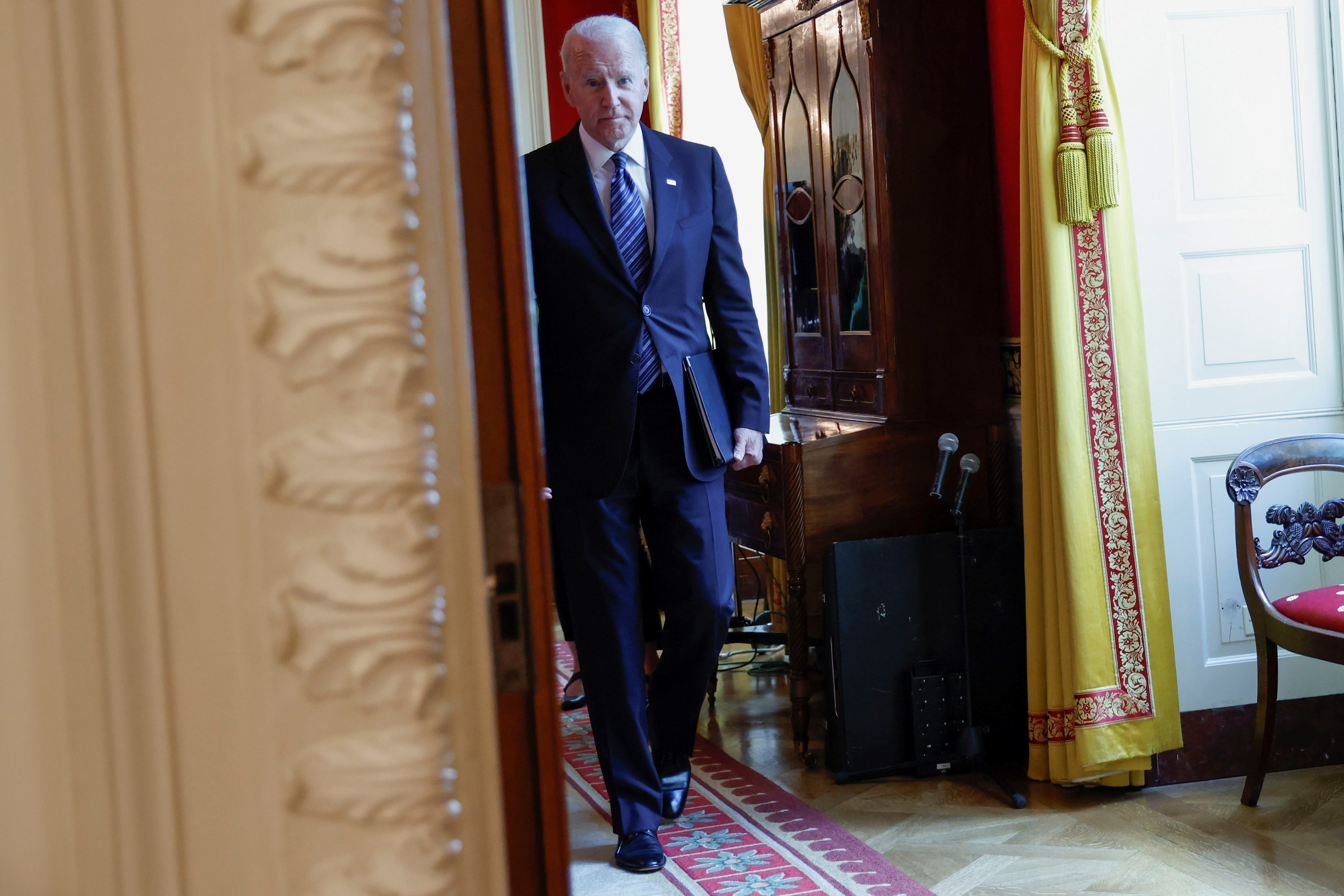 U.S. President Joe Biden walks to deliver remarks after a roundtable discussion with advisors on steps to curtail U.S. gun violence, at the White House in Washington, U.S. June 23, 2021. REUTERS/Jonathan Ernst