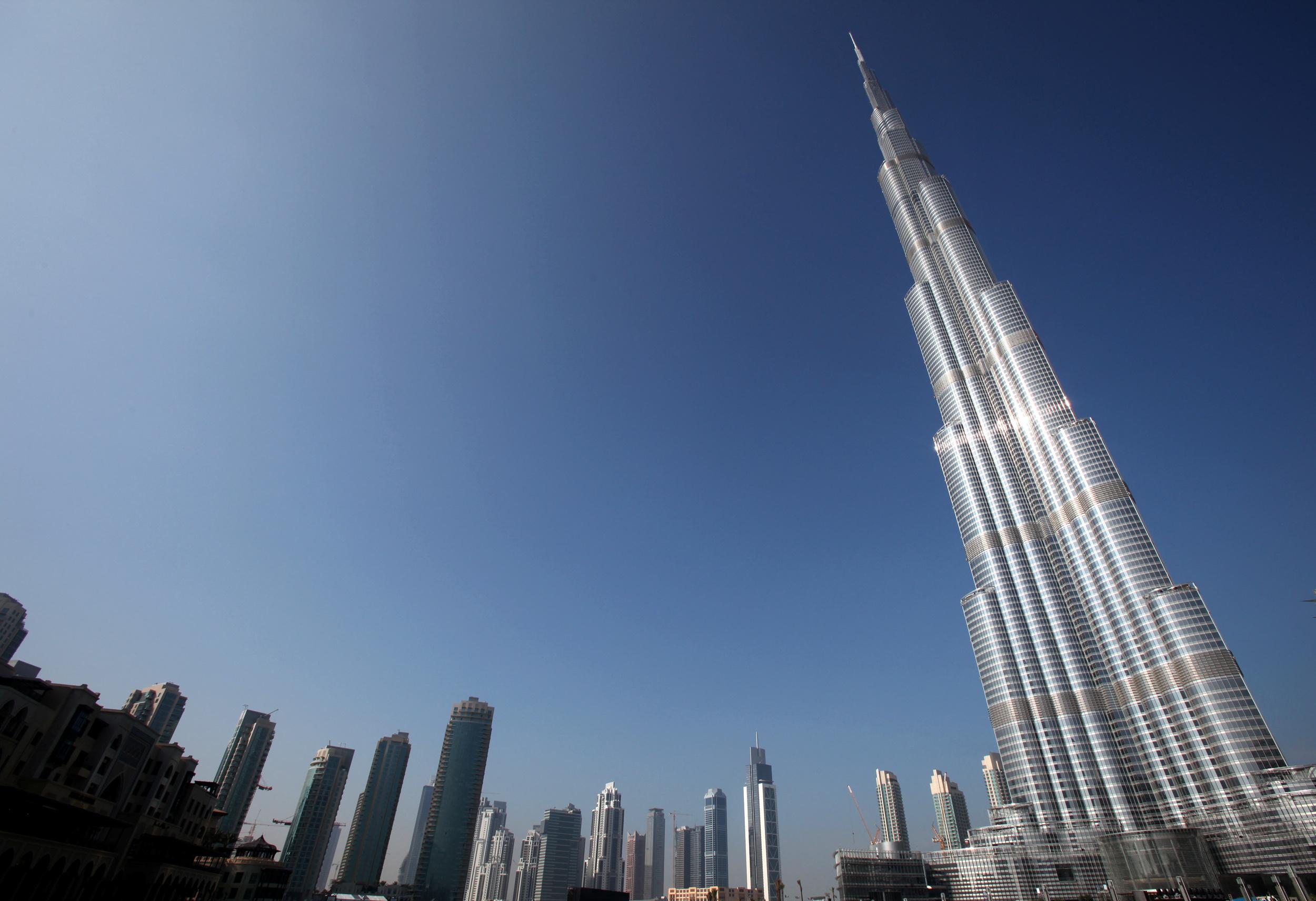 The skyline of Dubai shows the Burj Dubai Tower, the tallest tower in the world January 4, 2010. REUTERS/Ahmed Jadallah/File Photo