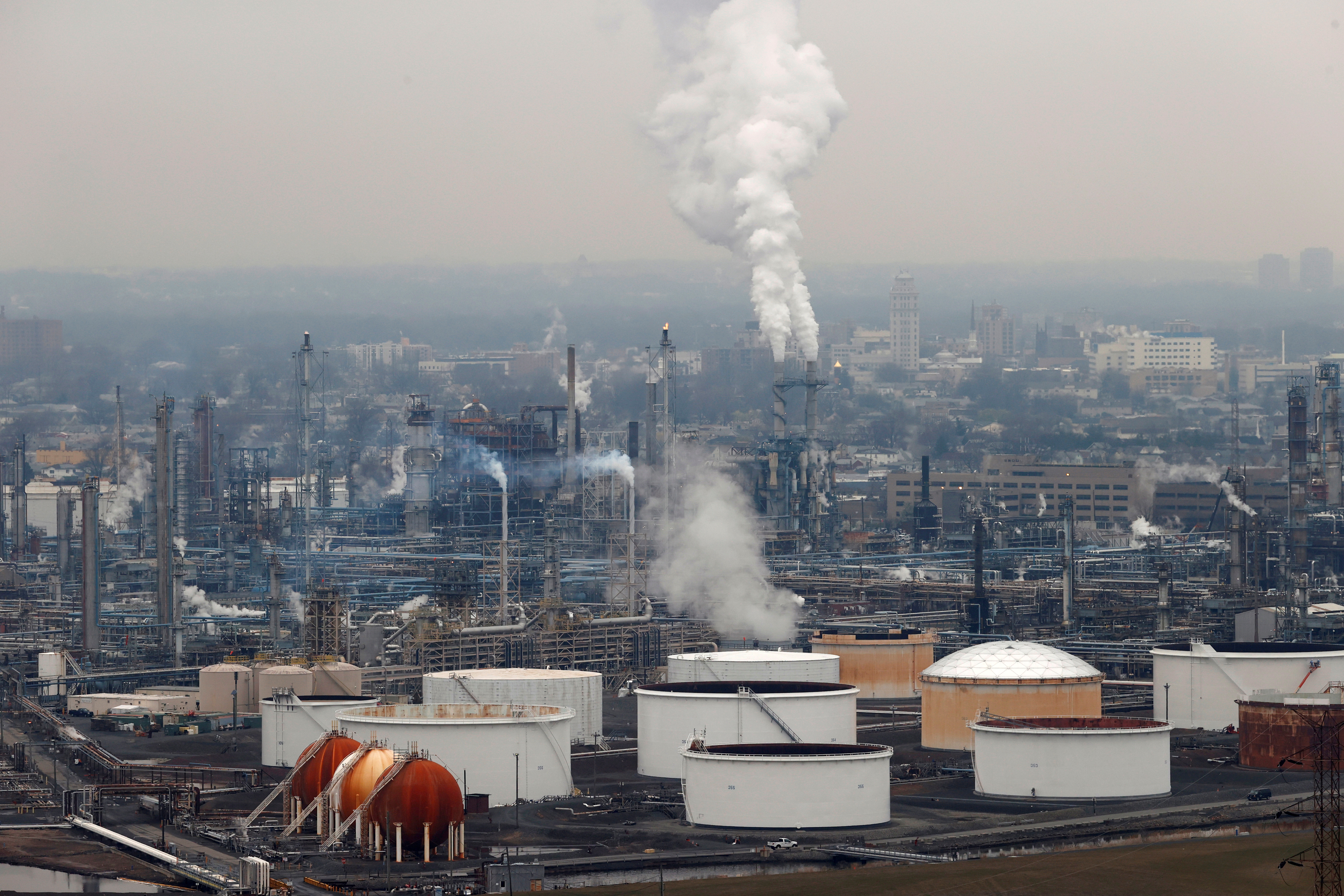 General view of oil tanks and the Bayway Refinery of Phillips 66 in Linden, New Jersey, U.S., March 30, 2020. REUTERS/Mike Segar