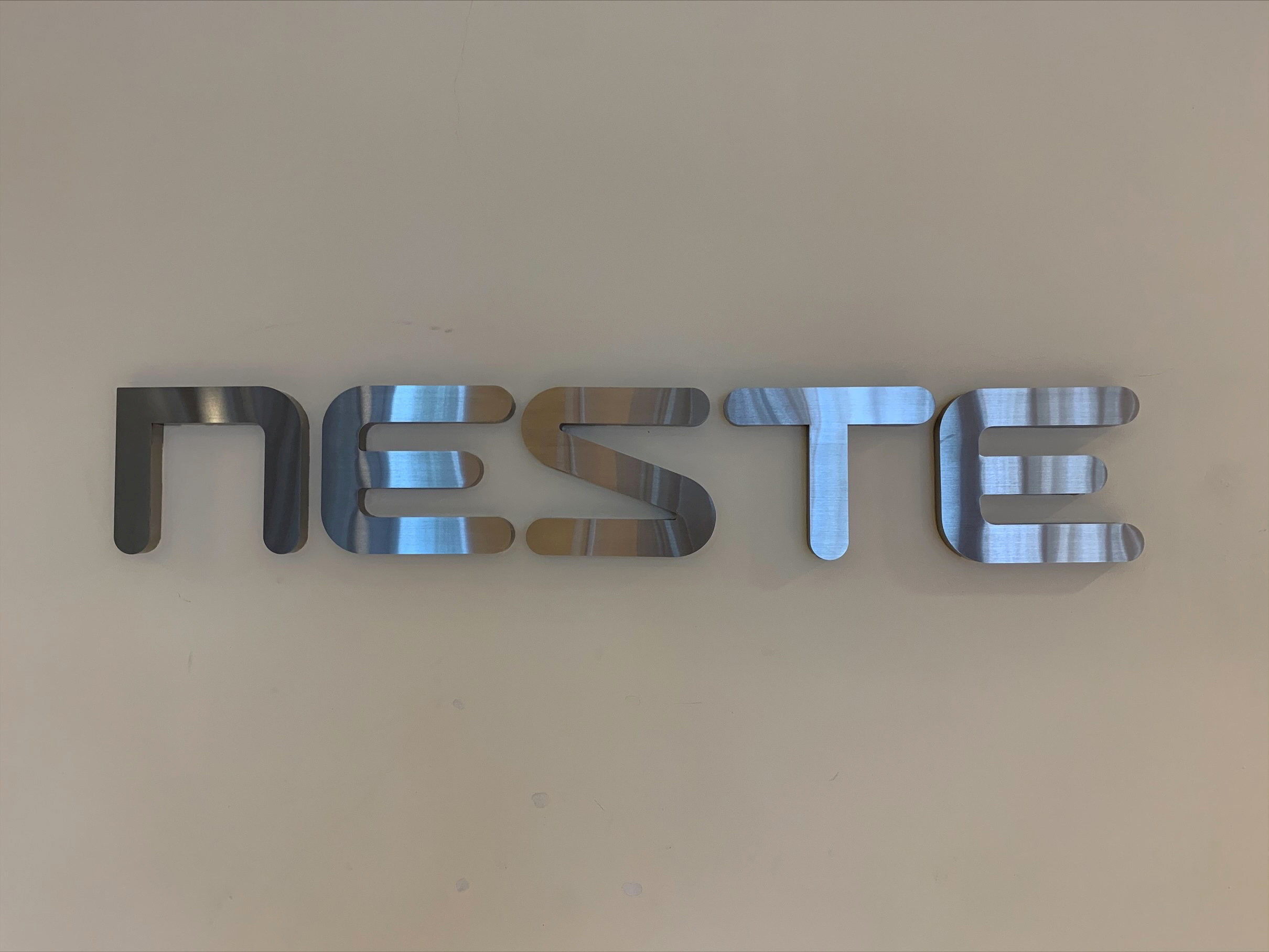 Neste's signage is pictured at their refinery in Singapore April 9, 2021.  REUTERS/Koustav Samanta