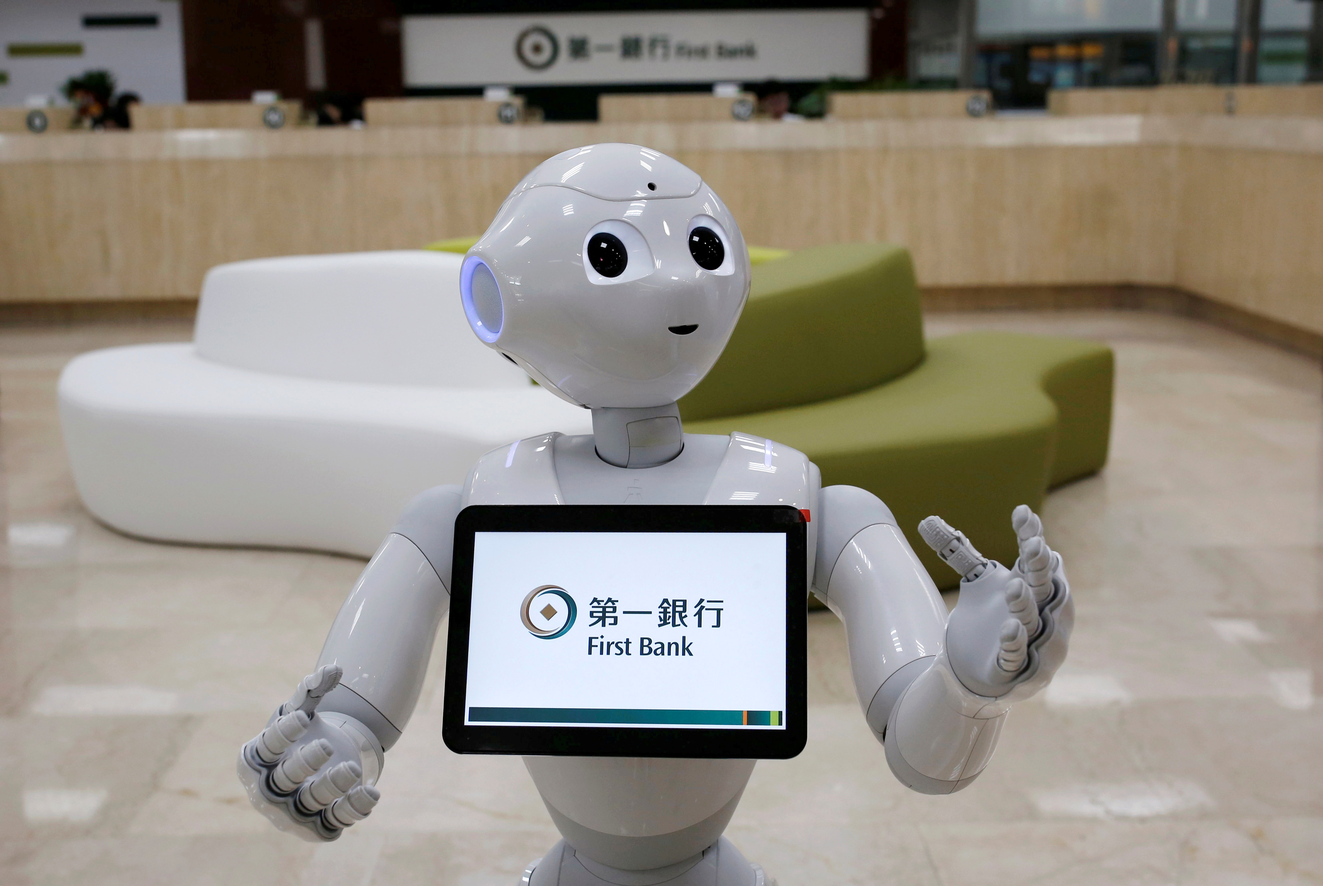 SoftBank's robot 'Pepper', is seen at First Bank branch as a concierge to welcome customers in Taipei, Taiwan October 6, 2016. REUTERS/Tyrone Siu/File Photo