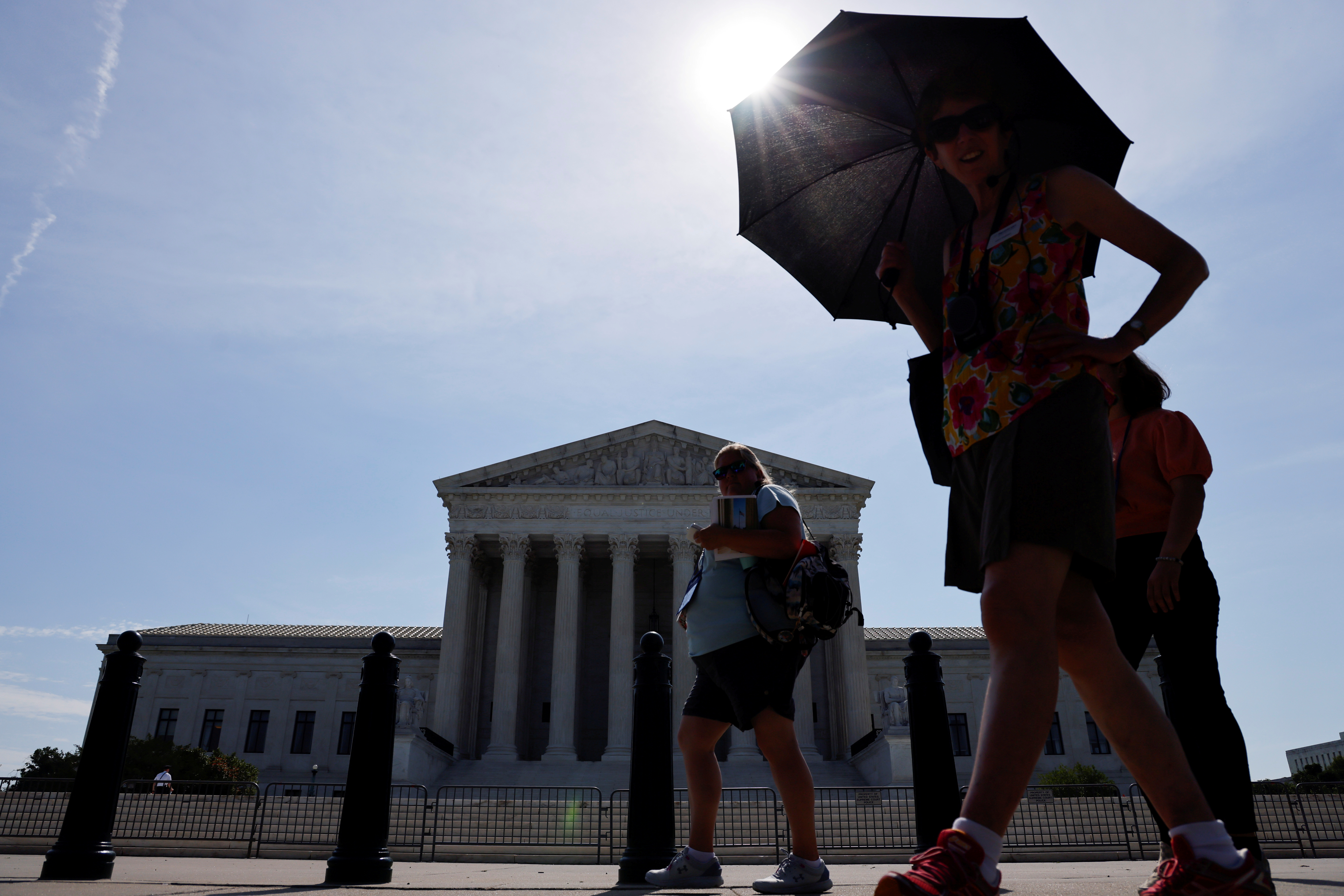 A tour group walks past the front of the U.S. Supreme Court building in Washington, U.S. June 7, 2021. REUTERS/Jonathan Ernst/File Photo