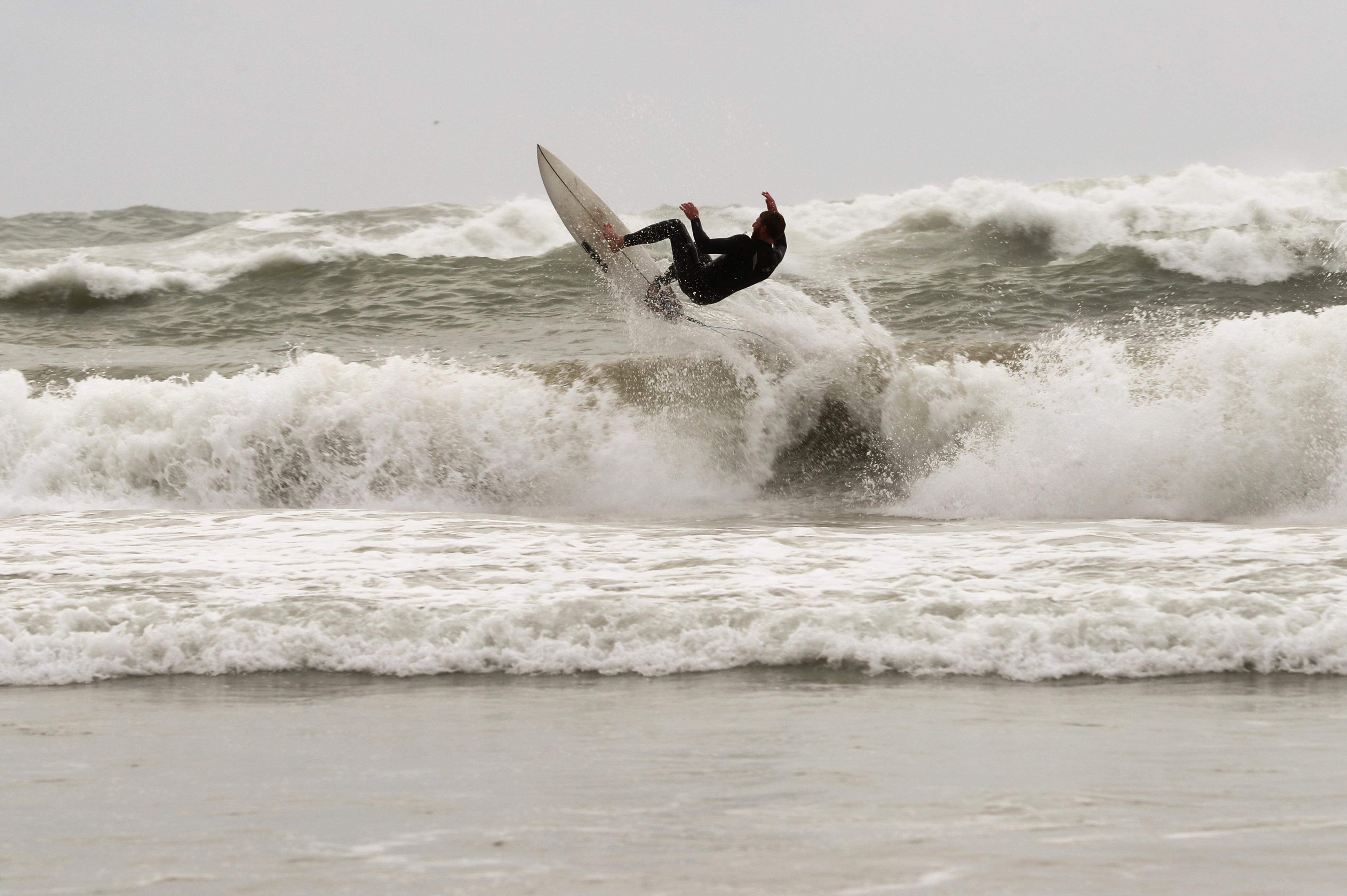 A man surfs in the Mediterranean Sea amid Israel's third national lockdown to curb rising coronavirus disease (COVID-19) infections, at a beach in Tel Aviv, Israel January 19, 2021. REUTERS/Ammar Awad