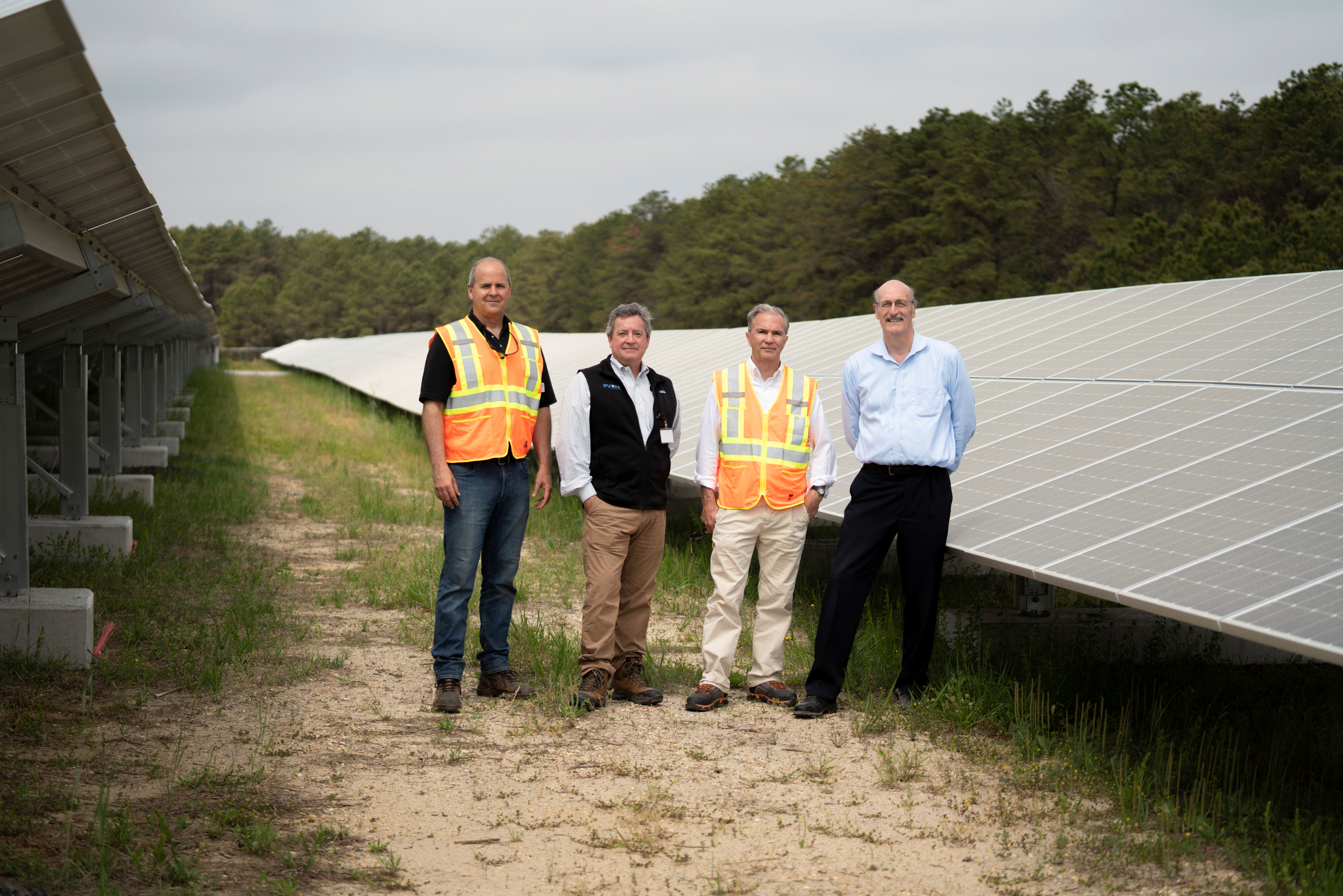 EDF Renewables Director Felix Aguayo, PV One Principal, Elliott Shanley, EDF Renewables Director Thomas Leyden, and BASF Sites Manager Charlie Waltz at the Toms River Solar Farm which was built on an EPA Superfund site in Toms River, New Jersey, U.S., 26 May, 2021. REUTERS/Dane Rhys