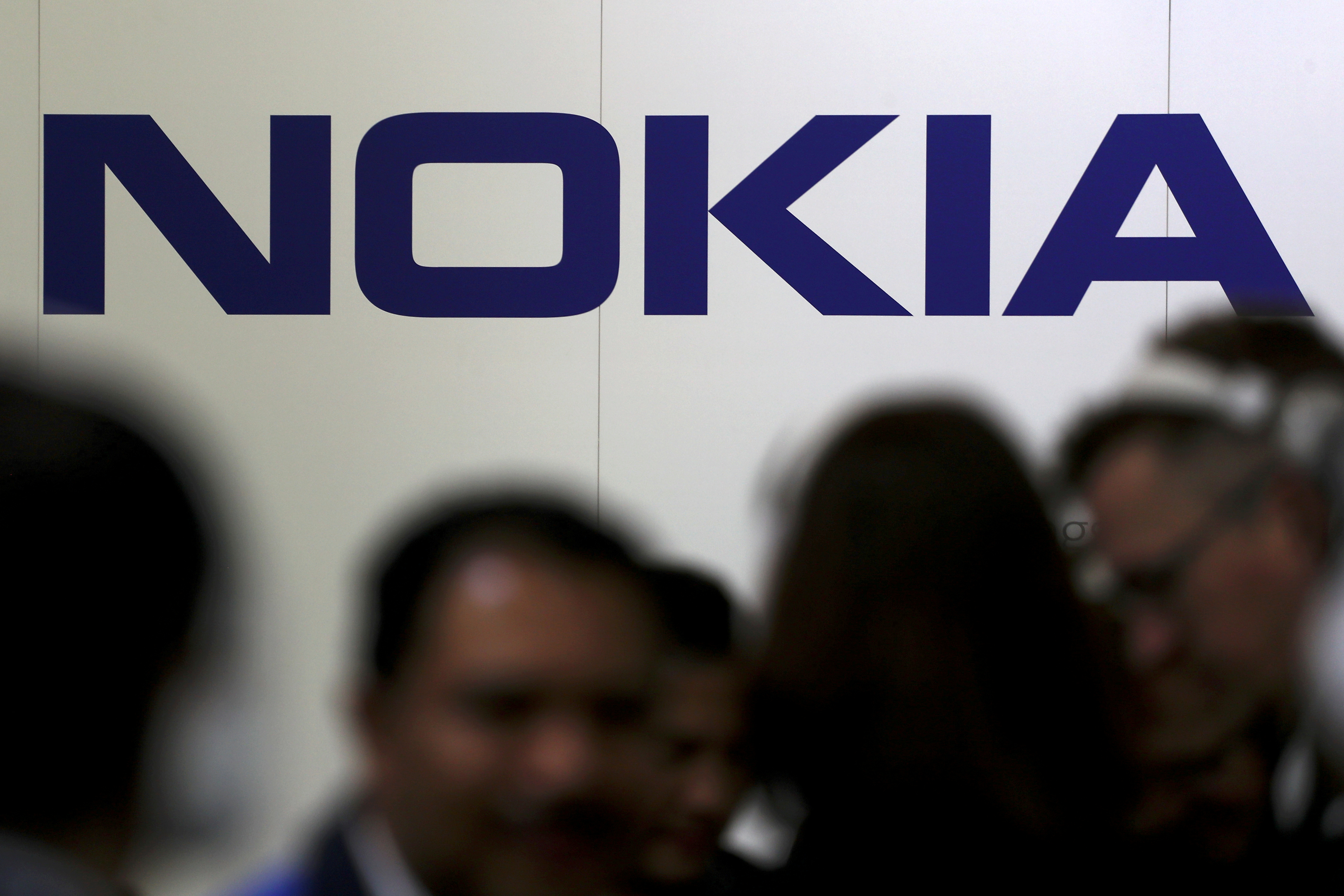 Visitors gather outside the Nokia booth at the Mobile World Congress in Barcelona, Spain, February 26, 2019. REUTERS/Sergio Perez