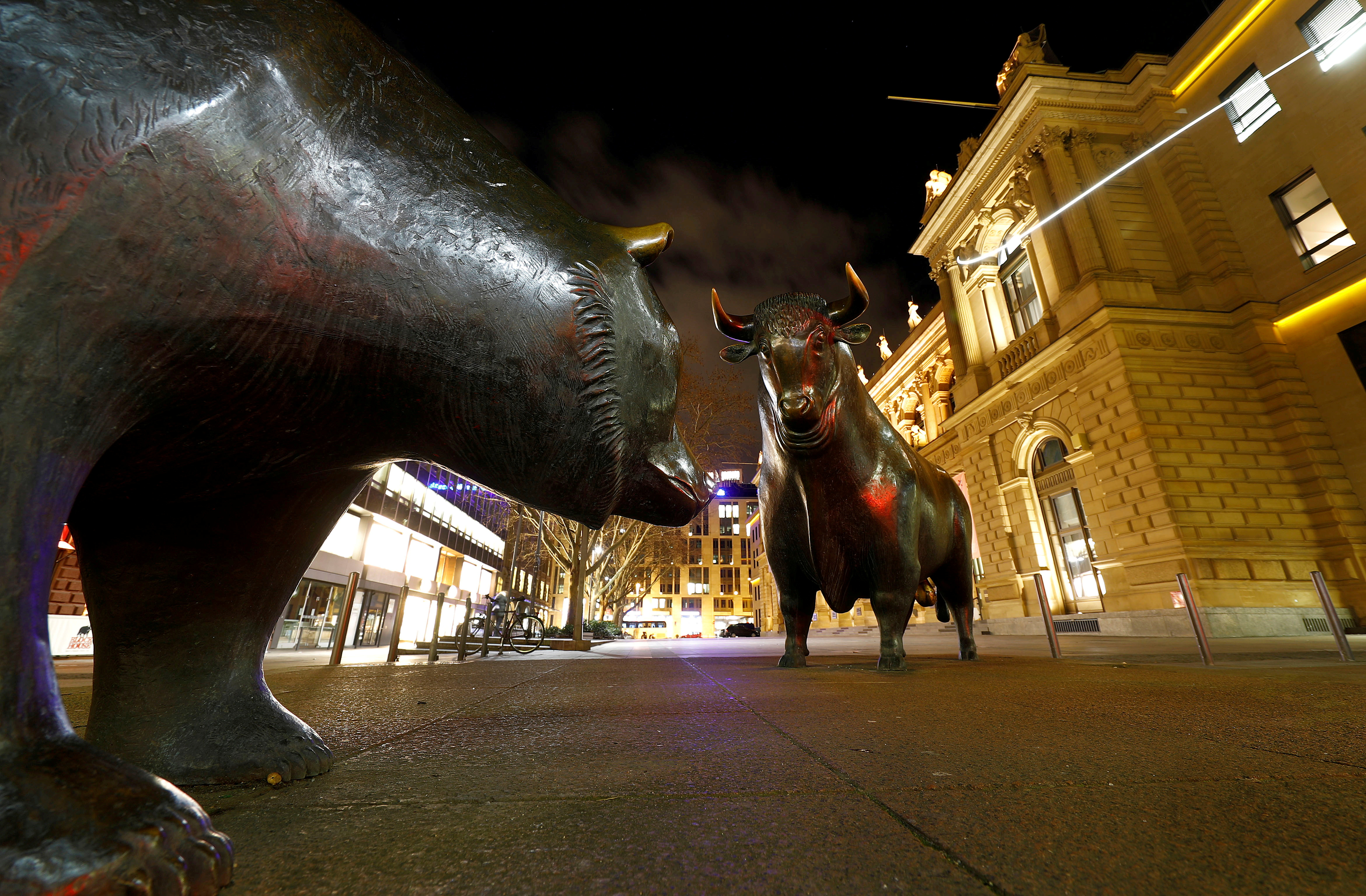 Bull and bear symbols for successful and bad trading are seen in front of the German stock exchange (Deutsche Boerse) in Frankfurt, Germany, February 12, 2019.  REUTERS/Kai Pfaffenbach/File Photo