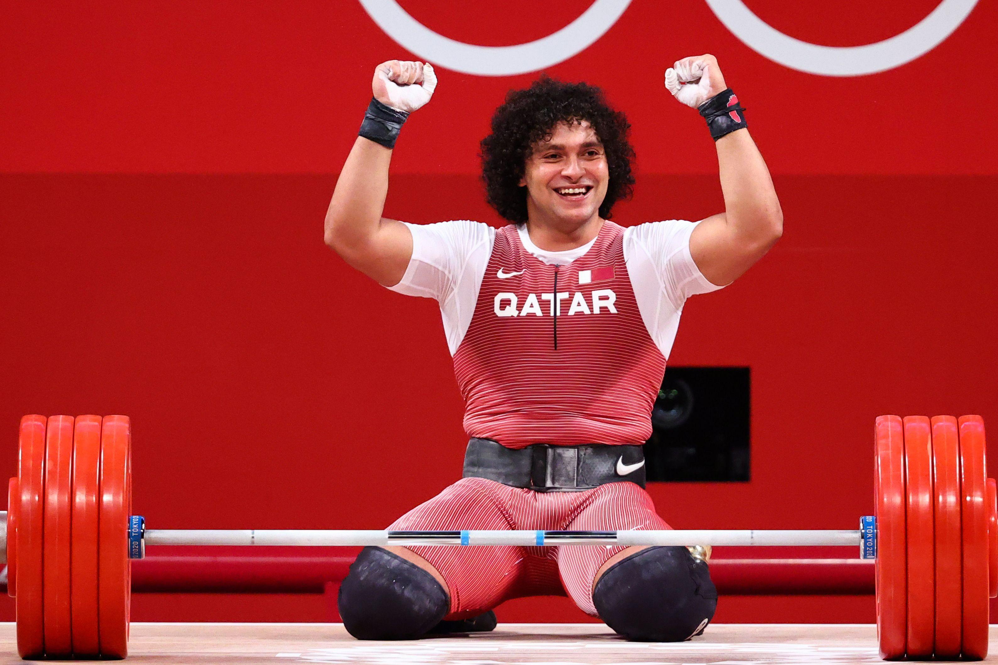 Tokyo 2020 Olympics - Weightlifting - Men's 96kg - Group A - Tokyo International Forum, Tokyo, Japan - July 31, 2021. Fares Ibrahim Elbakh of Qatar celebrates. REUTERS/Edgard Garrido