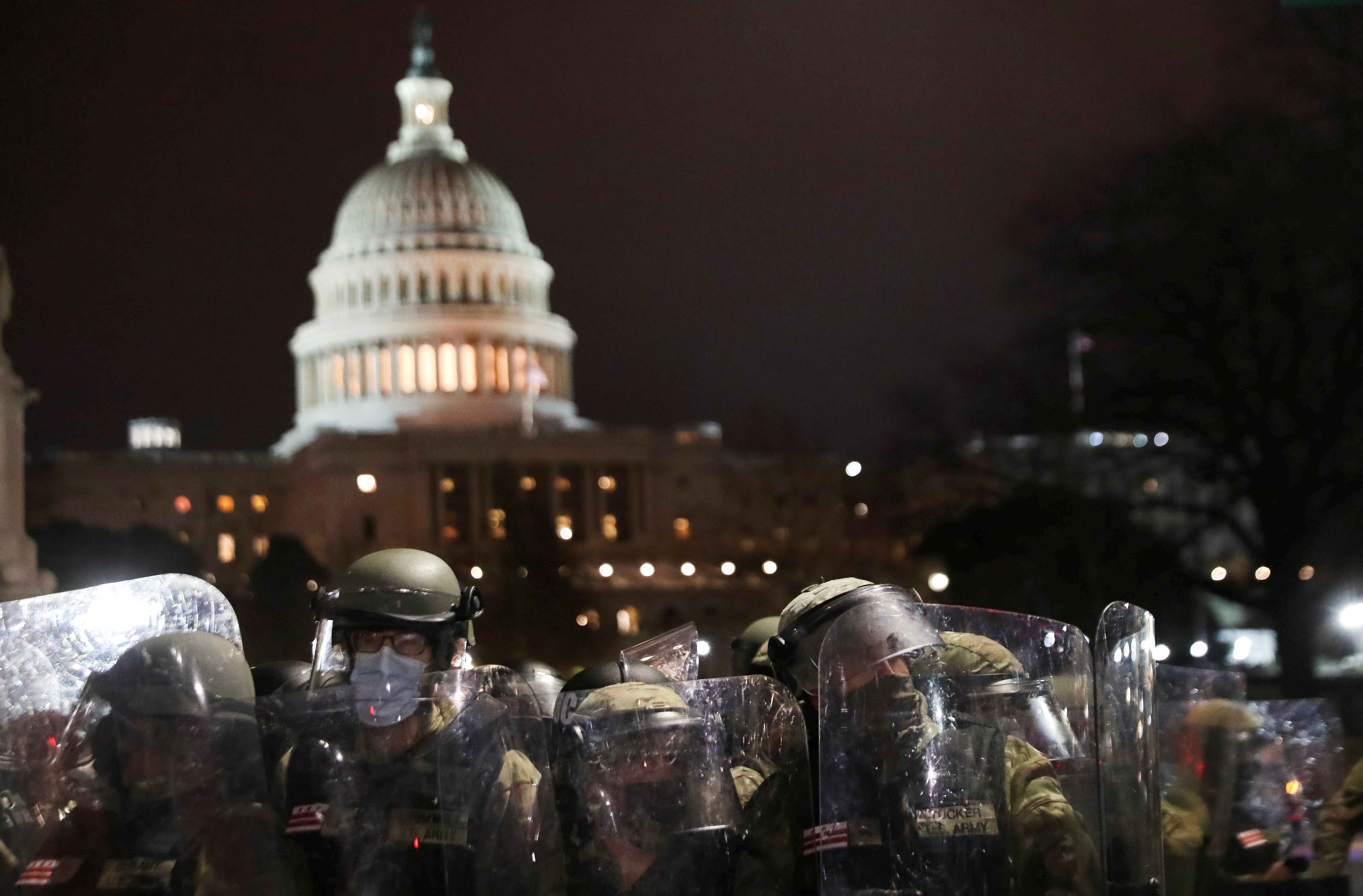 Members of the National Guard stand guard as supporters of U.S. President Donald Trump gather outside the U.S. Capitol building during a protest against the certification of the 2020 U.S. presidential election results by the U.S. Congress, in Washington, U.S., January 6, 2021.REUTERS/Leah Millis