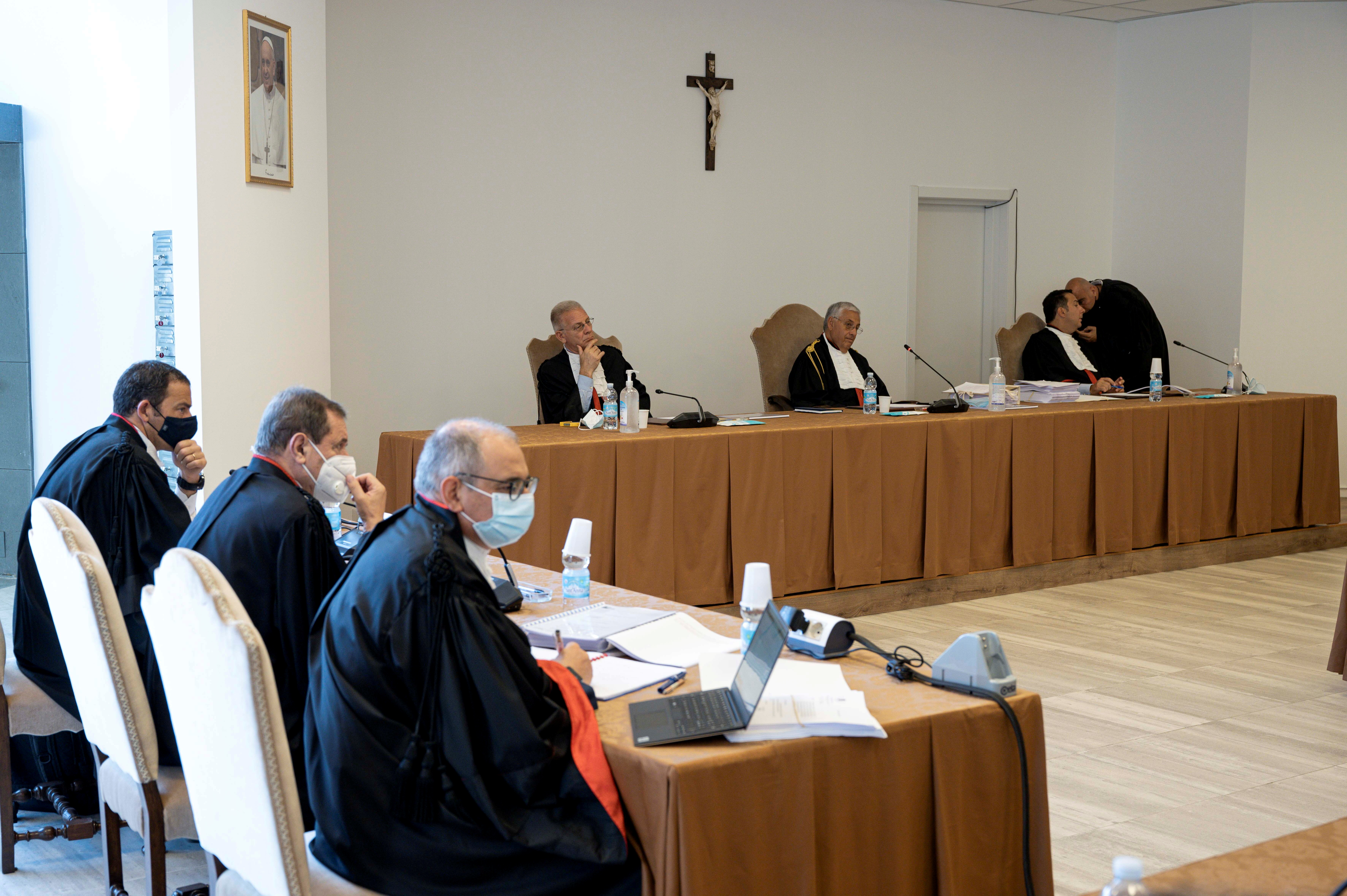 Trial begins at the Vatican for 10 people, including prominent Italian cardinal Angelo Becciu, who are charged with financial crimes including embezzlement, money laundering, fraud, extortion and abuse of office, at the Vatican, July 27, 2021. Vatican Media/Handout via REUTERS