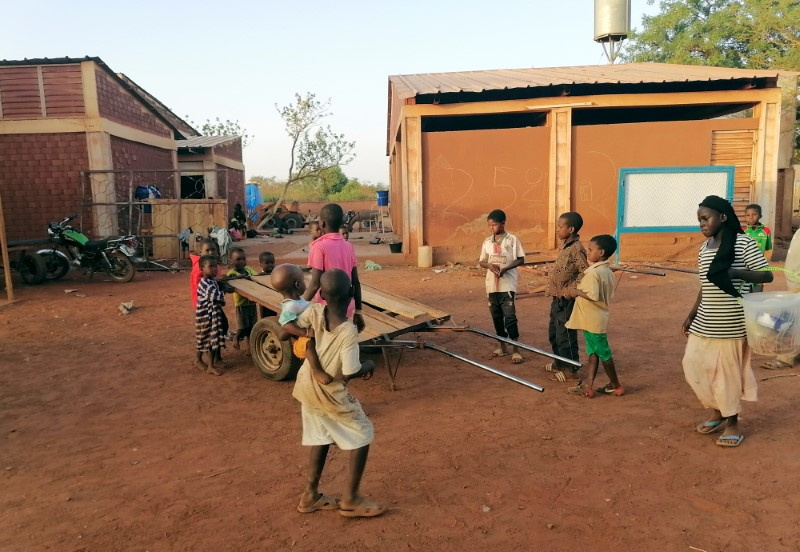 Children play during the visit of the Emir Djibril Diallo, chief negotiator in the talks between the jihadists and the Thiou population, at the displaced camp of Ouahigouya, Burkina Faso April 10, 2021.  REUTERS/Ndiaga Thiam