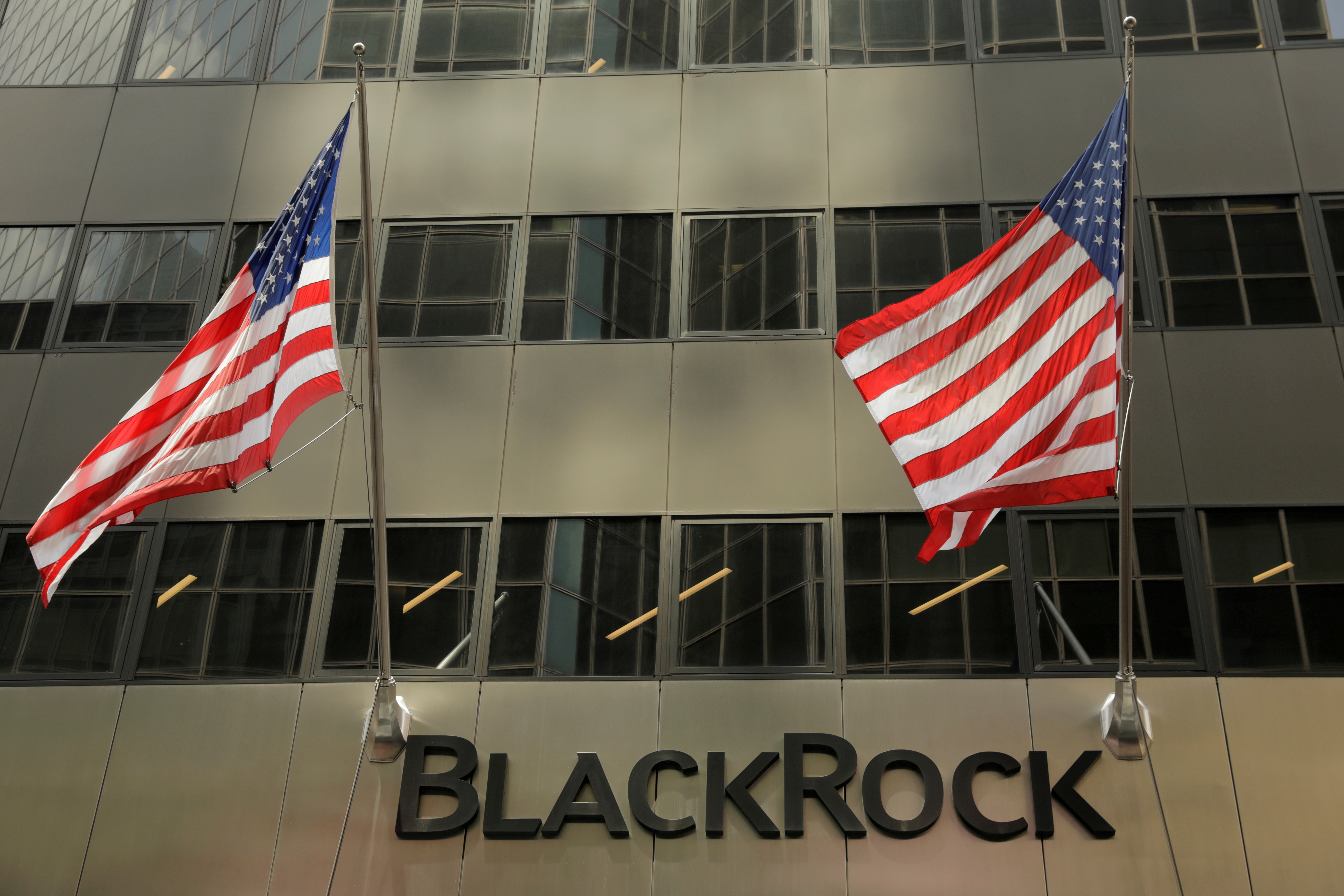 A sign for BlackRock Inc hangs above their building in New York U.S., July 16, 2018. REUTERS/Lucas Jackson
