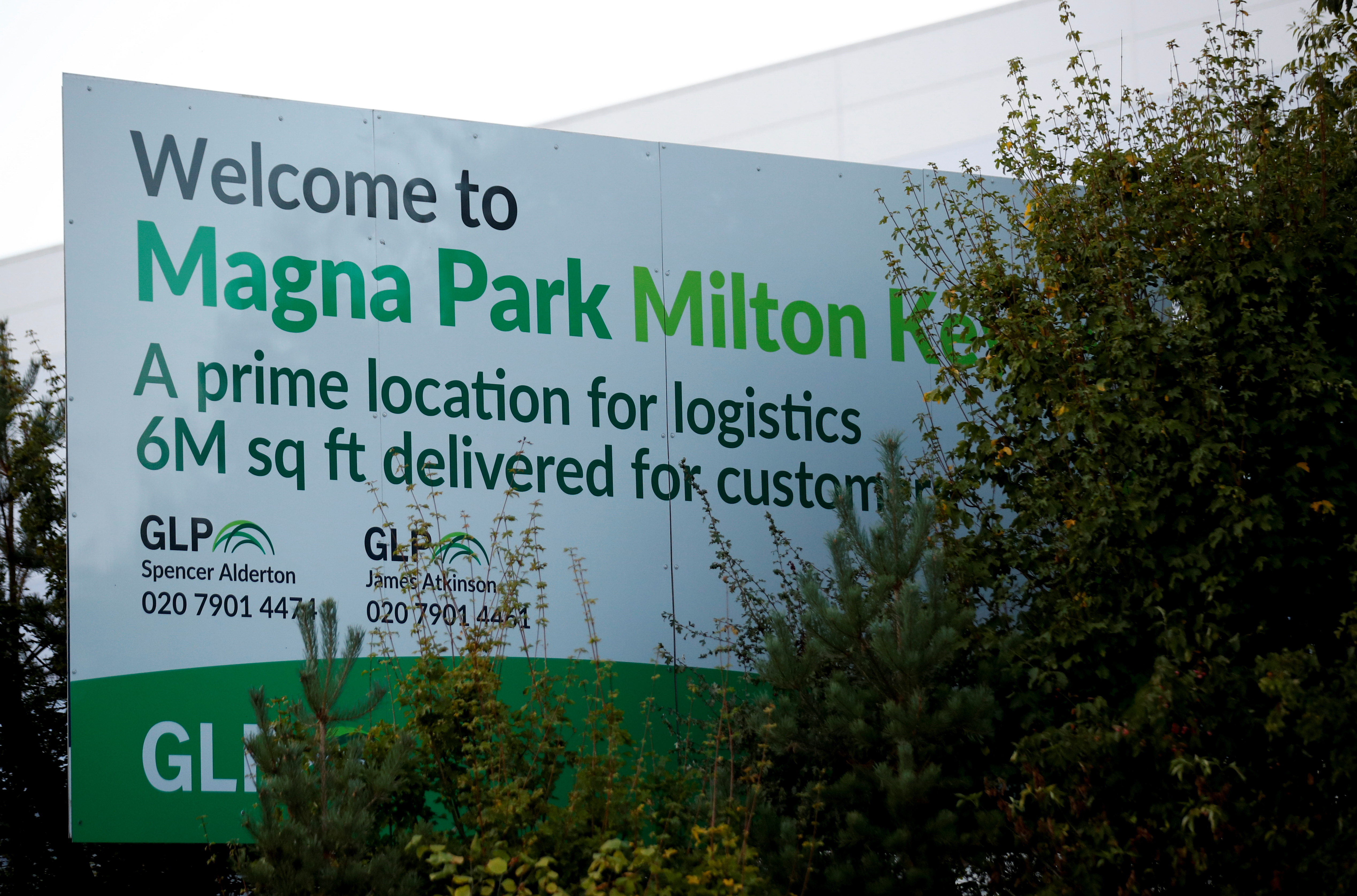 A welcome sign is seen at Magna Park in Milton Keynes, Britain, September 26, 2021. REUTERS/Andrew Boyers