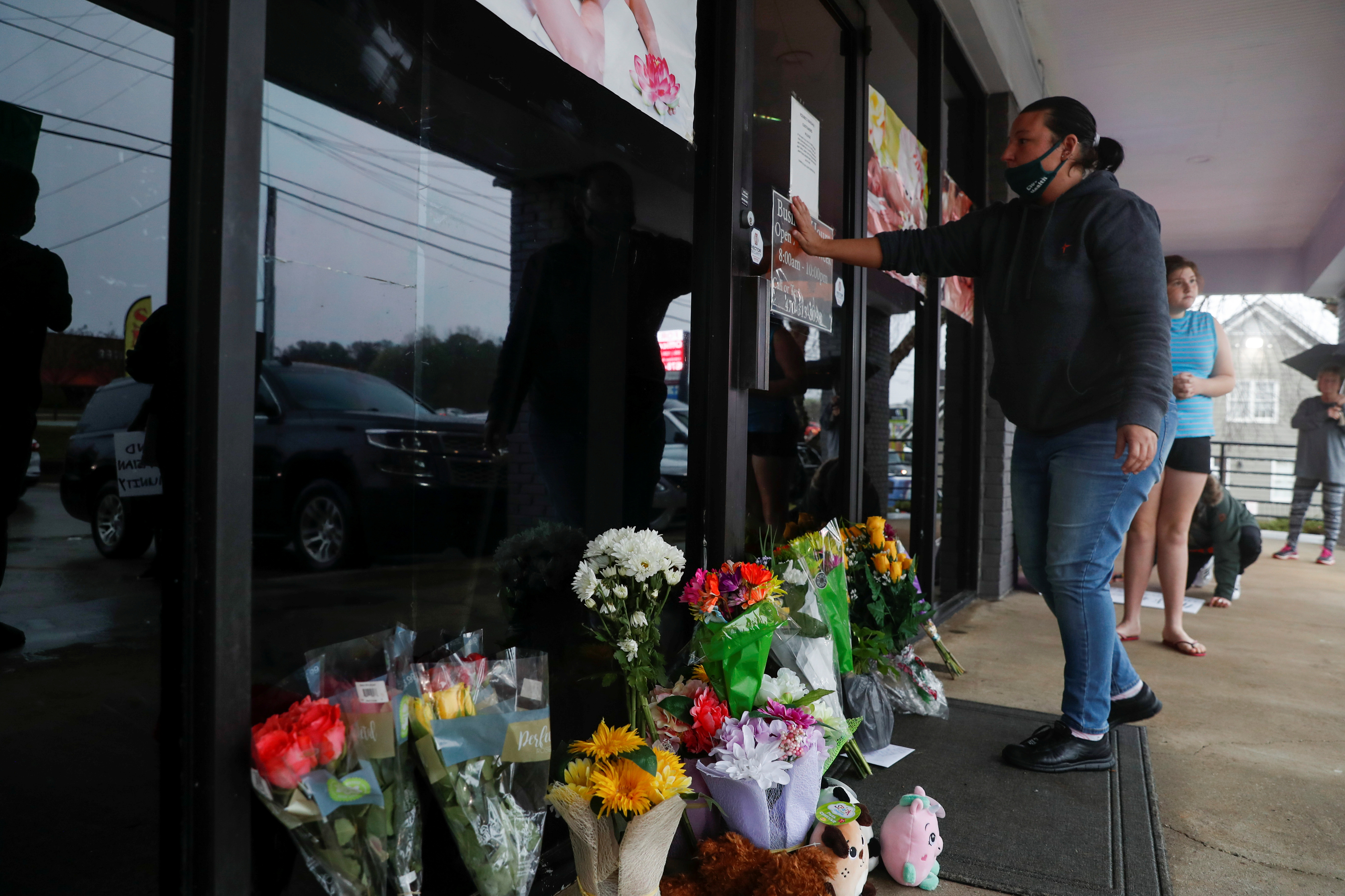 People leave flowers outside Young