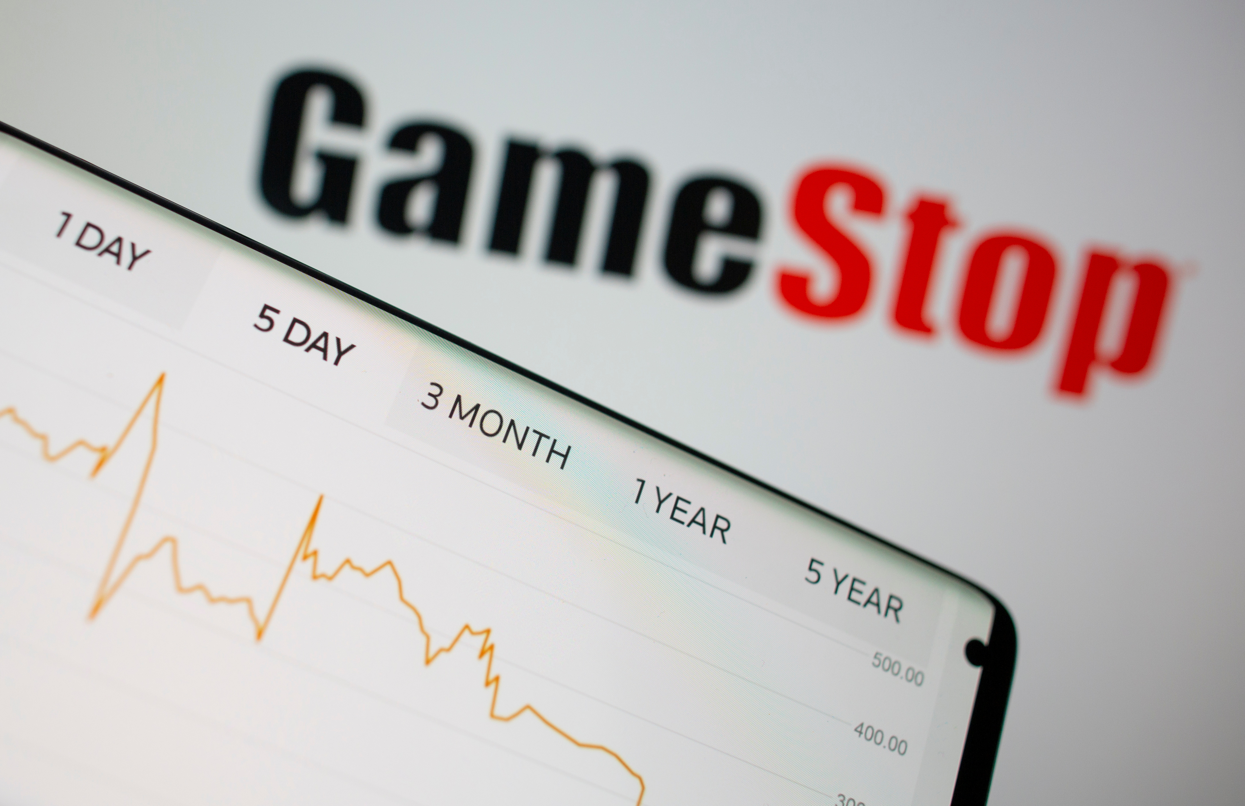 GameStop stock graph is seen in front of the company's logo in this illustration taken February 2, 2021. REUTERS/Dado Ruvic/Illustration