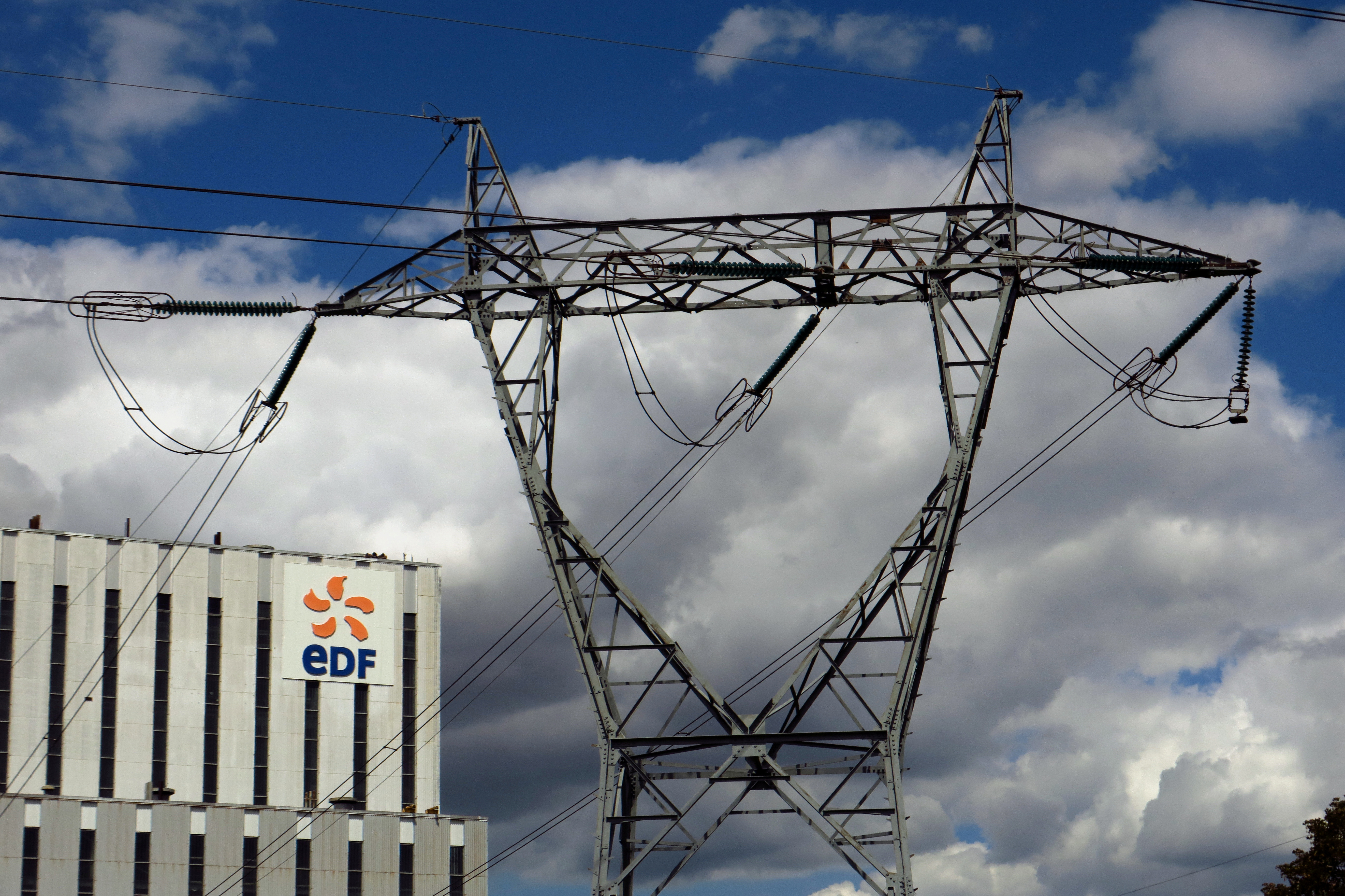 Electrical power pylons of high-tension electricity power lines are seen next to the EDF power plant in Bouchain, near Valenciennes, France, July 7, 2020. REUTERS/Pascal Rossignol