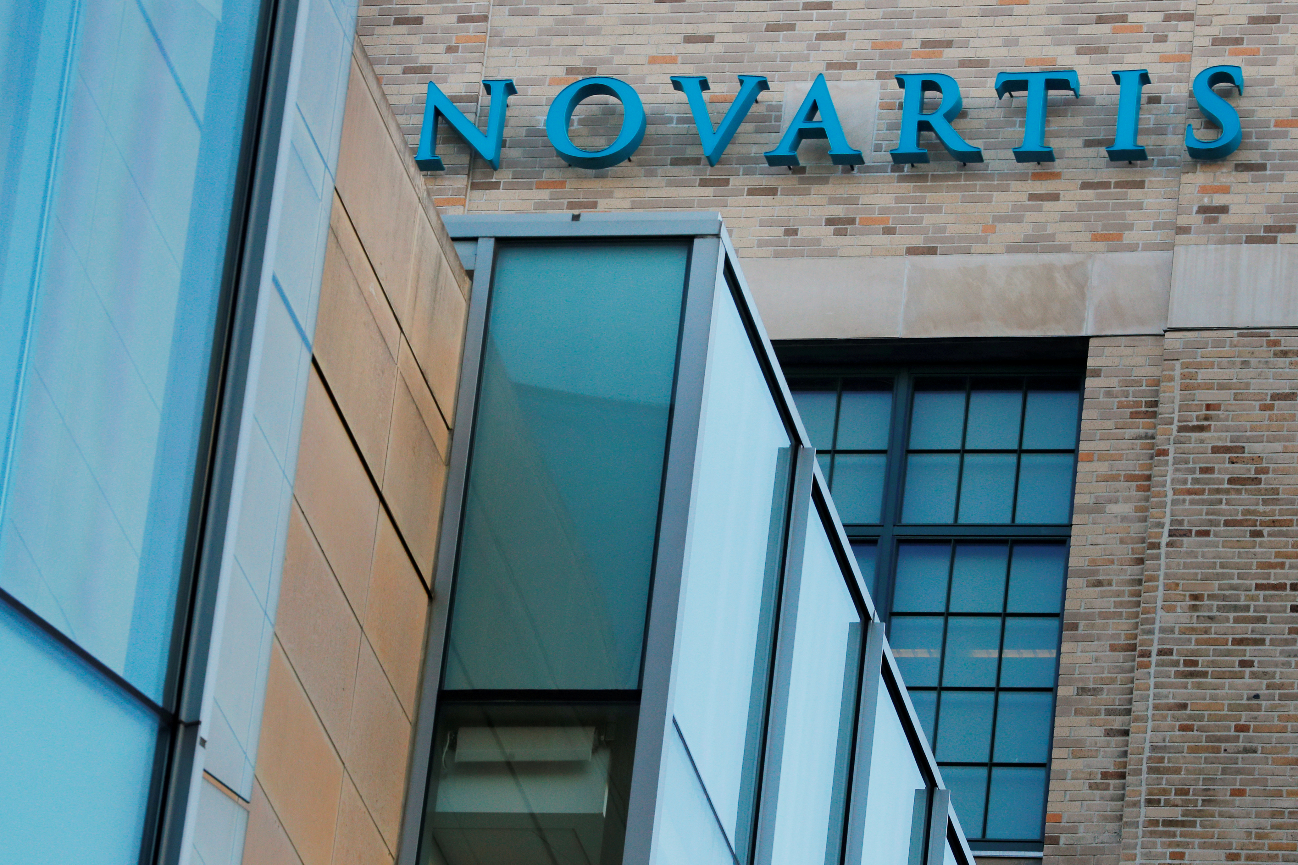 A sign marks Novartis' Institutes for Biomedical Research in Cambridge, Massachusetts, U.S., January 2, 2020.  Picture taken January 2, 2020. REUTERS/Brian Snyder/File Photo