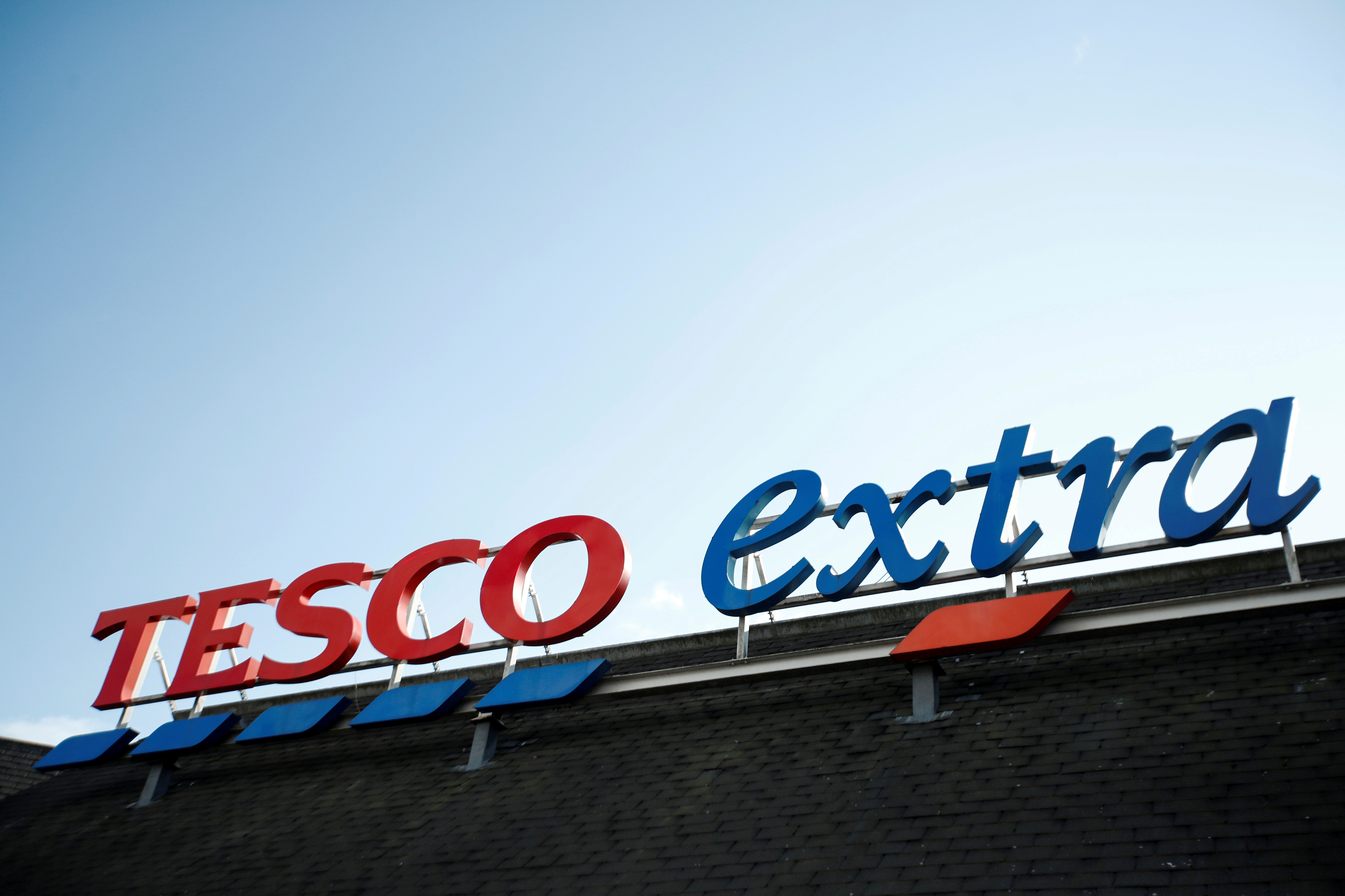 A logo of Tesco is pictured outside a Tesco supermarket in Hatfield, Britain October 6, 2020. REUTERS/Peter Cziborra
