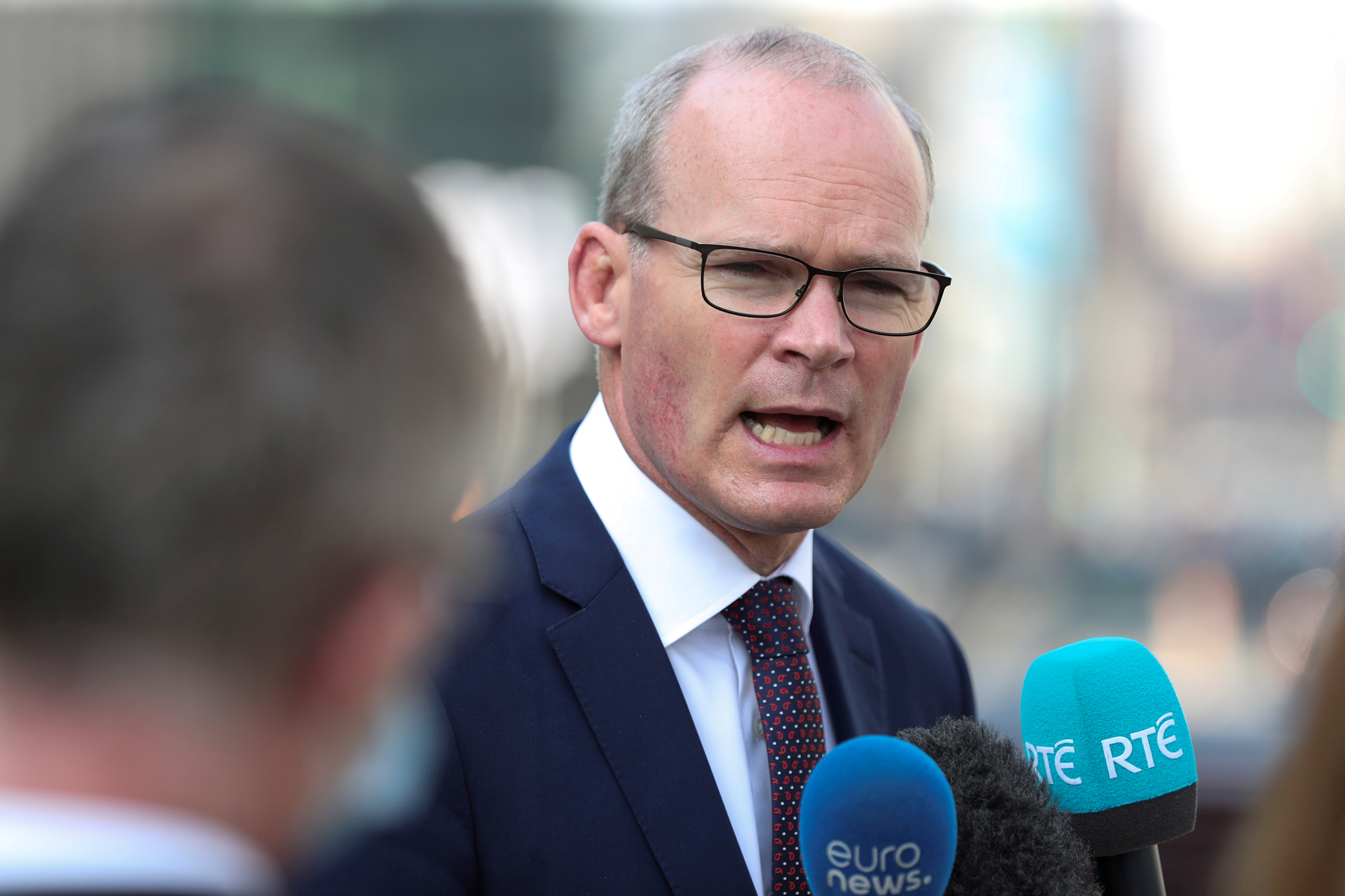 Irish Foreign Minister Simon Coveney, speaks to the media after a European general affairs ministers council, in Brussels, Belgium September 22, 2020. REUTERS/Yves Herman/File Photo