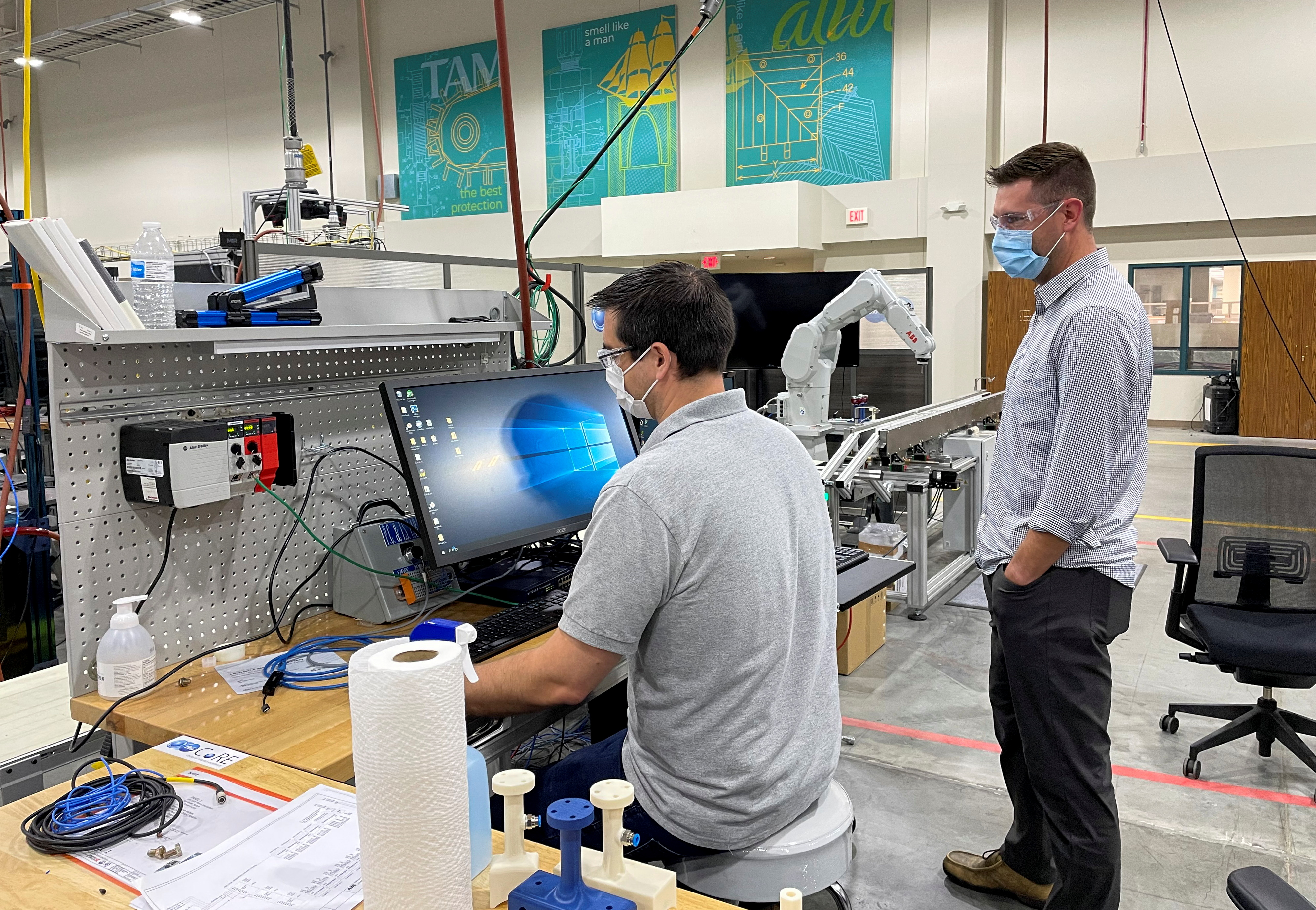 Researchers test new robots at Procter & Gamble's corporate engineering laboratory in Cincinnati, Ohio, U.S., May 27, 2021. Picture taken May 27, 2021. REUTERS/Timothy Aeppel