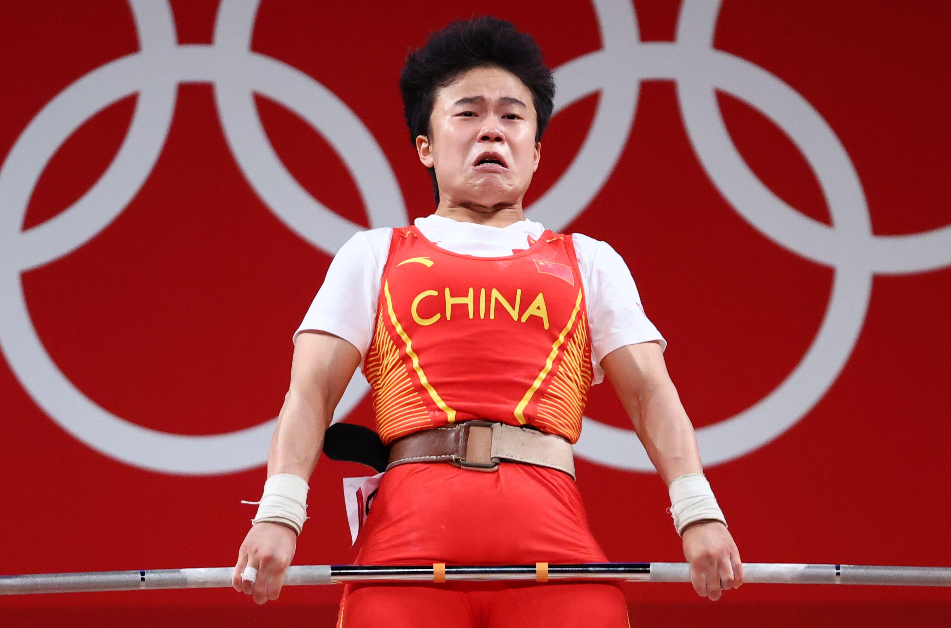 Tokyo 2020 Olympics - Weightlifting - Women's 49kg - Group A - Tokyo International Forum, Tokyo, Japan - July 24, 2021.  Hou Zhihui of China in action. REUTERS/Edgard Garrido