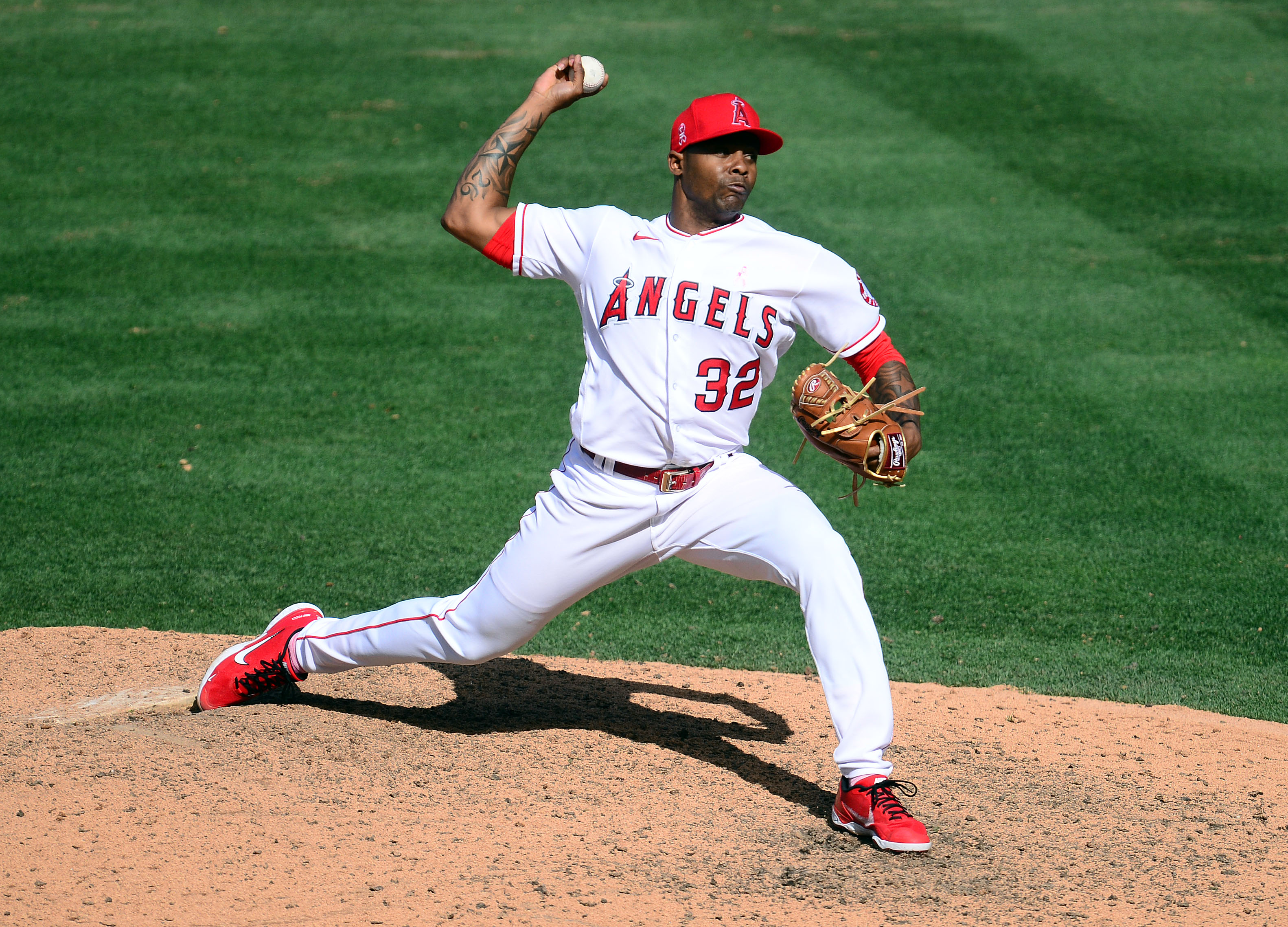 May 9, 2021; Anaheim, California, USA; Los Angeles Angels relief pitcher Raisel Iglesias (32) throws against the Los Angeles Dodgers during the ninth inning at Angel Stadium. Mandatory Credit: Gary A. Vasquez-USA TODAY Sports