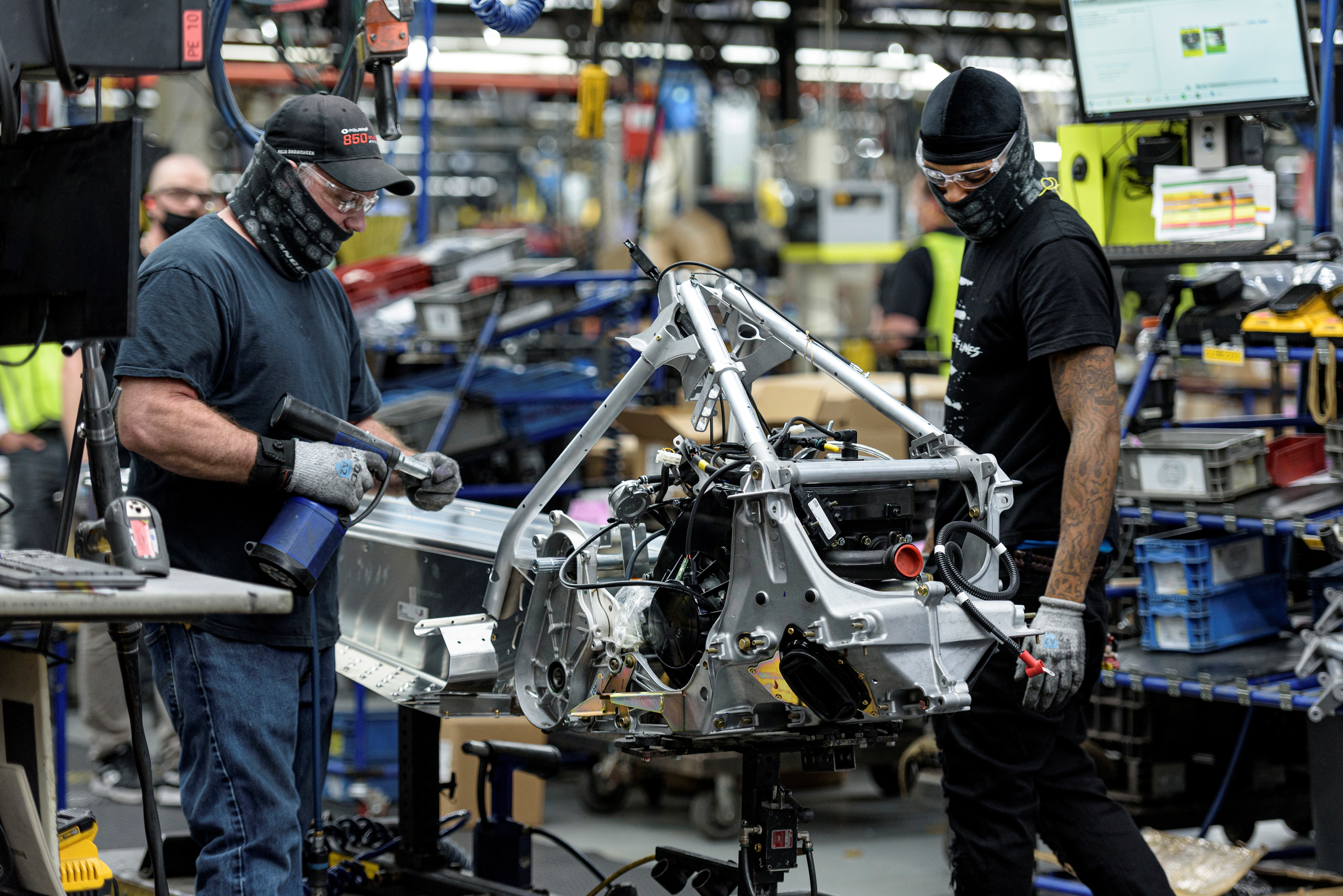 People work on a Polaris snowmobile assembly line at their manufacturing and assembly plant in Roseau, Minnesota, U.S. June 7, 2021. Picture taken June 7, 2021.  REUTERS/Dan Koeck