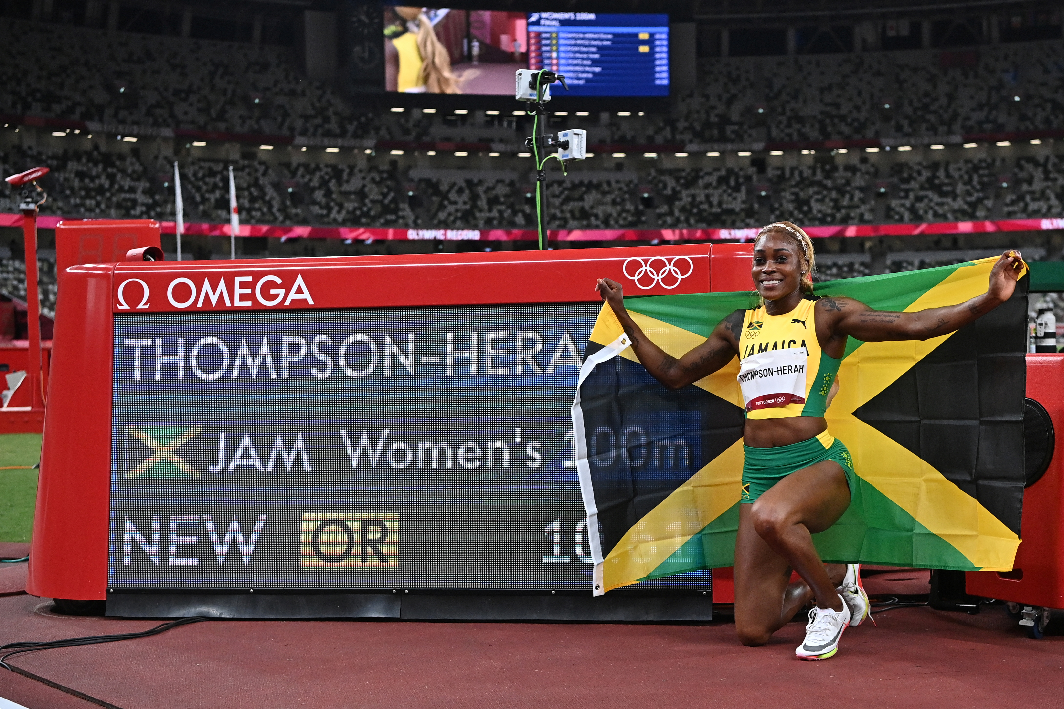 Tokyo 2020 Olympics - Athletics - Women's 100m - Final - OLS - Olympic Stadium, Tokyo, Japan - July 31, 2021. Gold medallist Elaine Thompson-Herah of Jamaica celebrates after winning and setting an Olympic Record Pool via Reuters/Ben Stansall