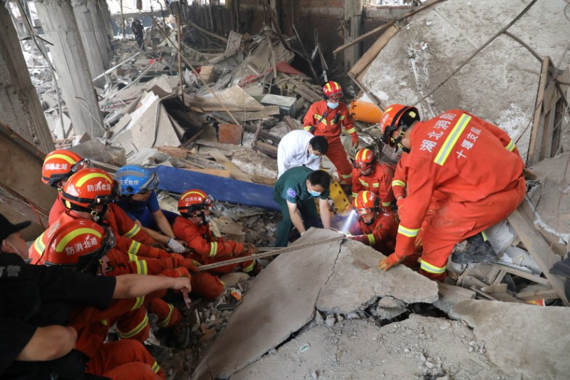 Rescue workers search for victims amid the debris following a gas pipeline explosion in Shiyan, Hubei province, China June 13, 2021. China Daily via REUTERS