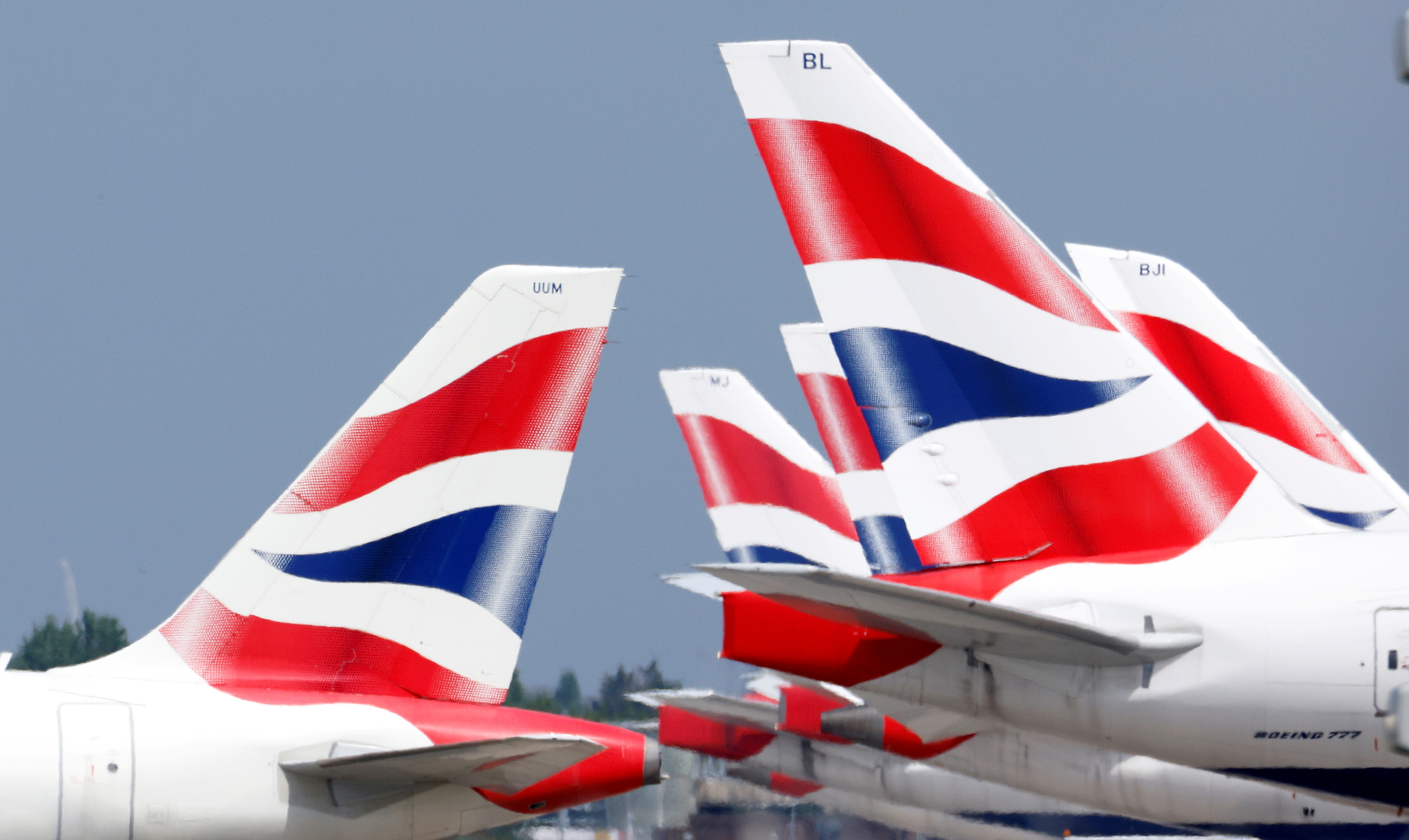 British Airways tail fins are pictured at Heathrow Airport in London, Britain, May 17, 2021. REUTERS/John Sibley//File Photo