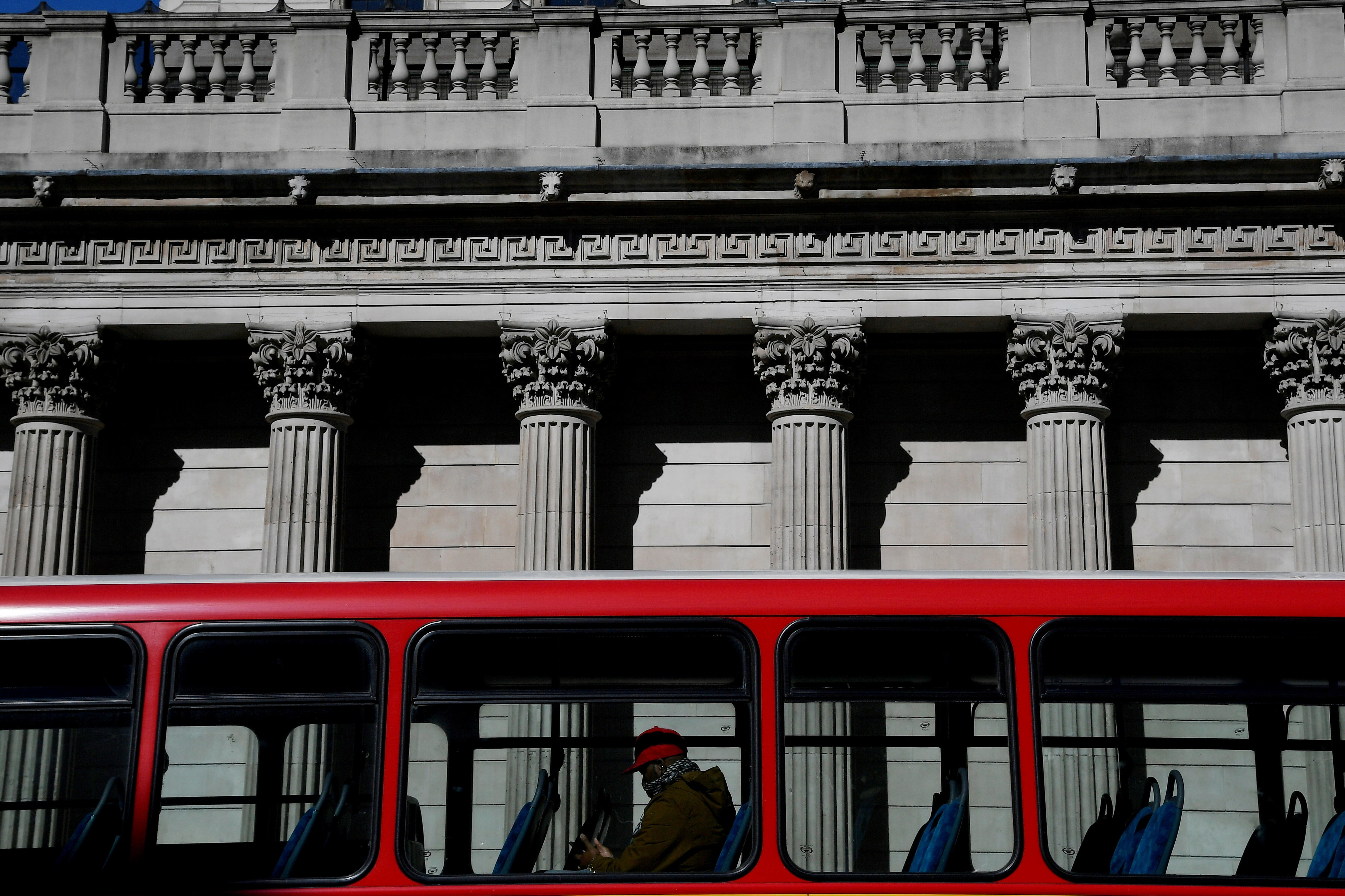 A quiet bus passes the Bank of England, as the spread of the coronavirus disease (COVID-19) continues, in London, Britain, March 23, 2020. REUTERS/Toby Melville//File Photo