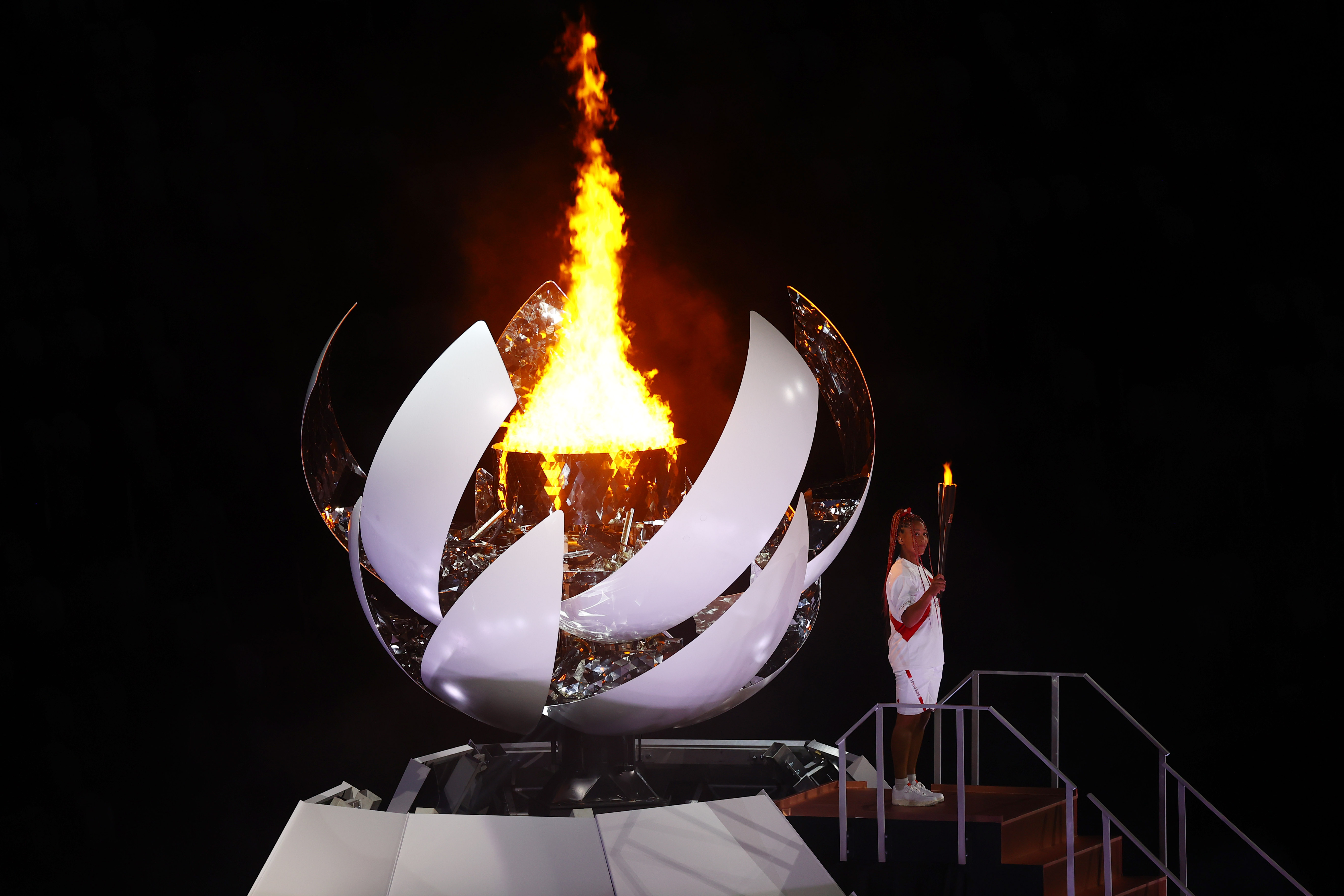 Tokyo 2020 Olympics - The Tokyo 2020 Olympics Opening Ceremony - Olympic Stadium, Tokyo, Japan - July 23, 2021. Naomi Osaka of Japan holds the Olympic torch after lighting the Olympic cauldron at the opening ceremony REUTERS/Mike Blake