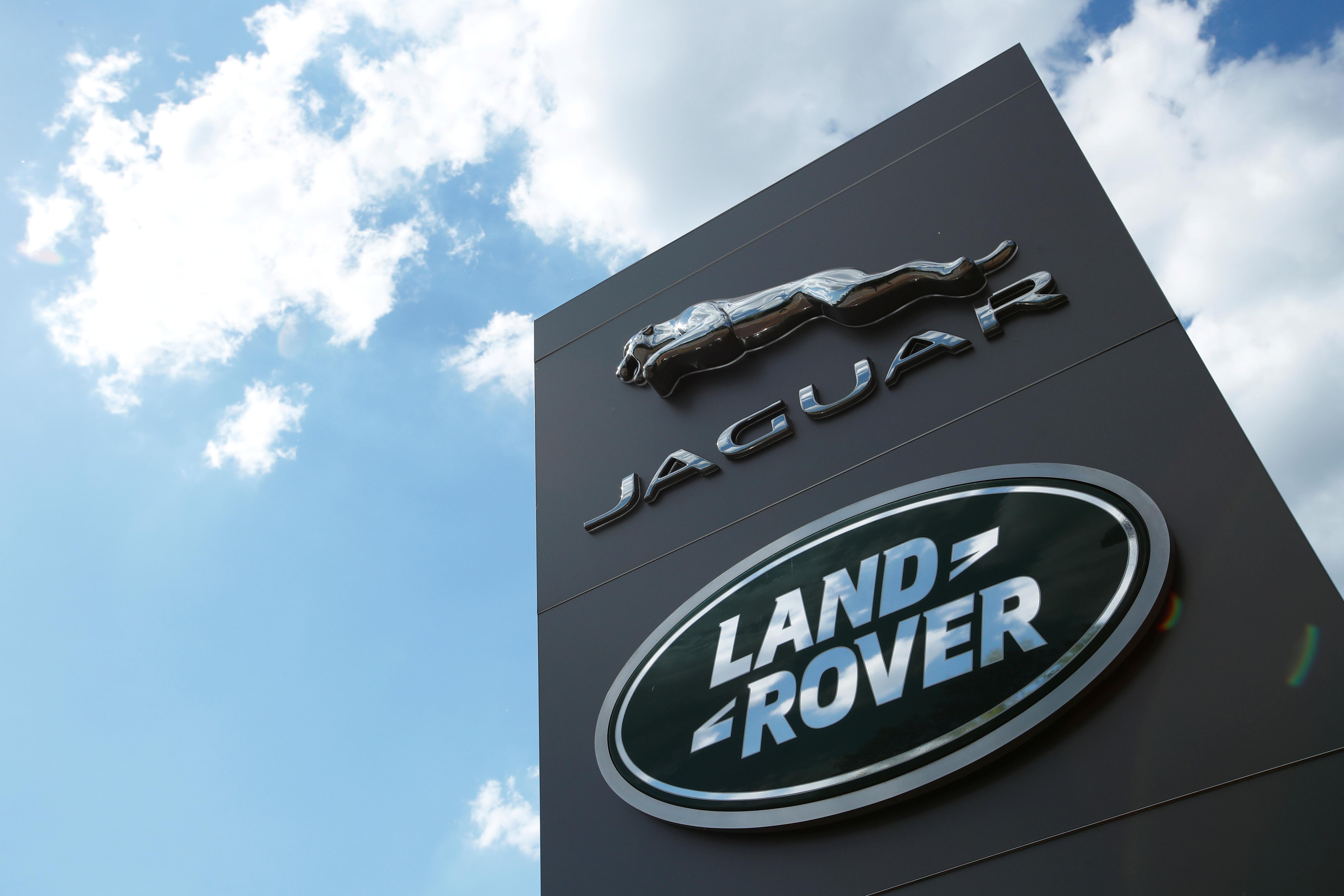 The Jaguar Land Rover logo is seen at a dealership, following the outbreak of the coronavirus disease (COVID-19), Milton Keynes, Britain, June 1, 2020. REUTERS/Andrew Boyers