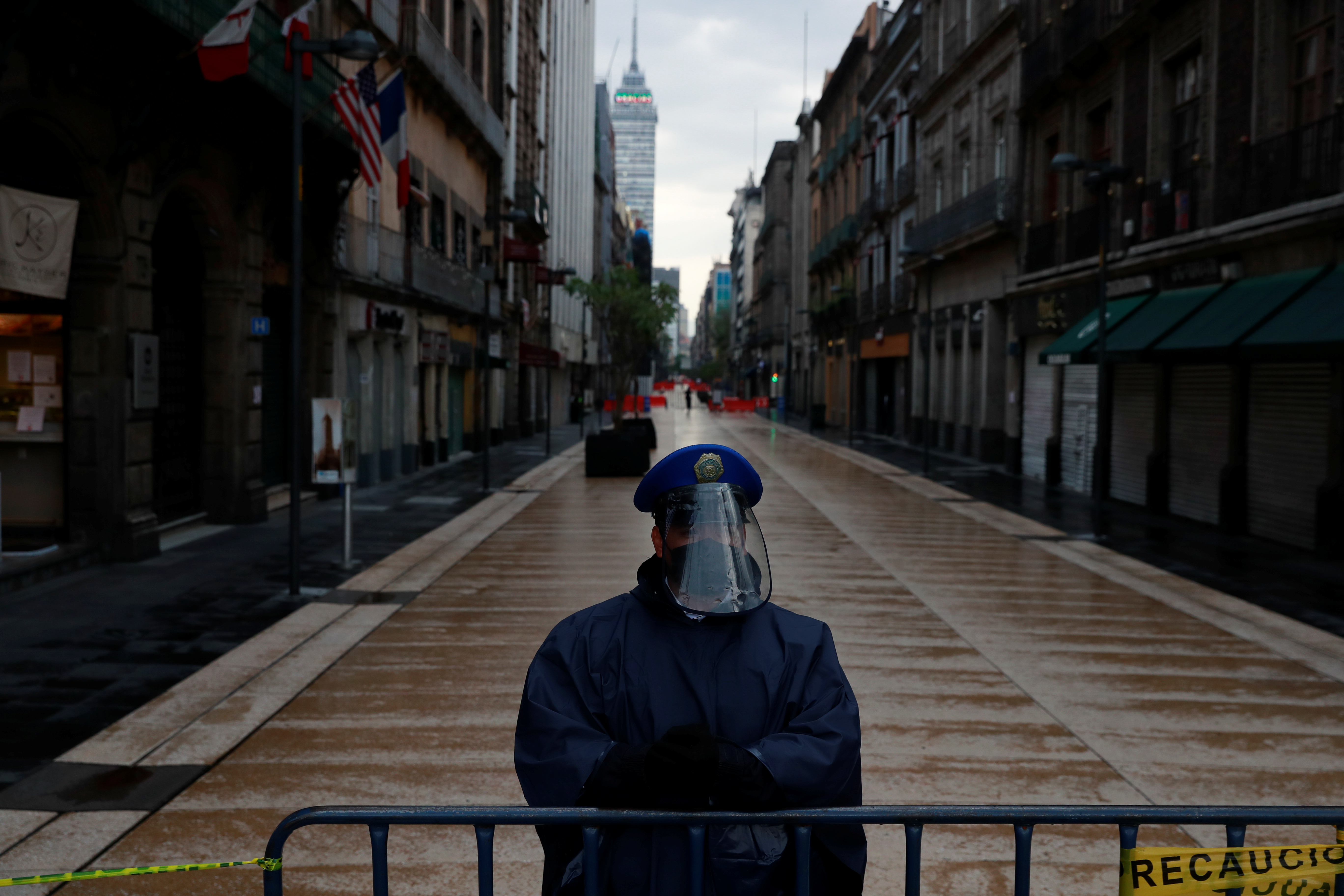 A police officer guards a closed road at the city center after amenities and businesses were shut for the second time this weekend due to overcrowding over the last few days, as the coronavirus disease (COVID-19) outbreak continues, in Mexico City, Mexico July 4, 2020. REUTERS/Carlos Jasso