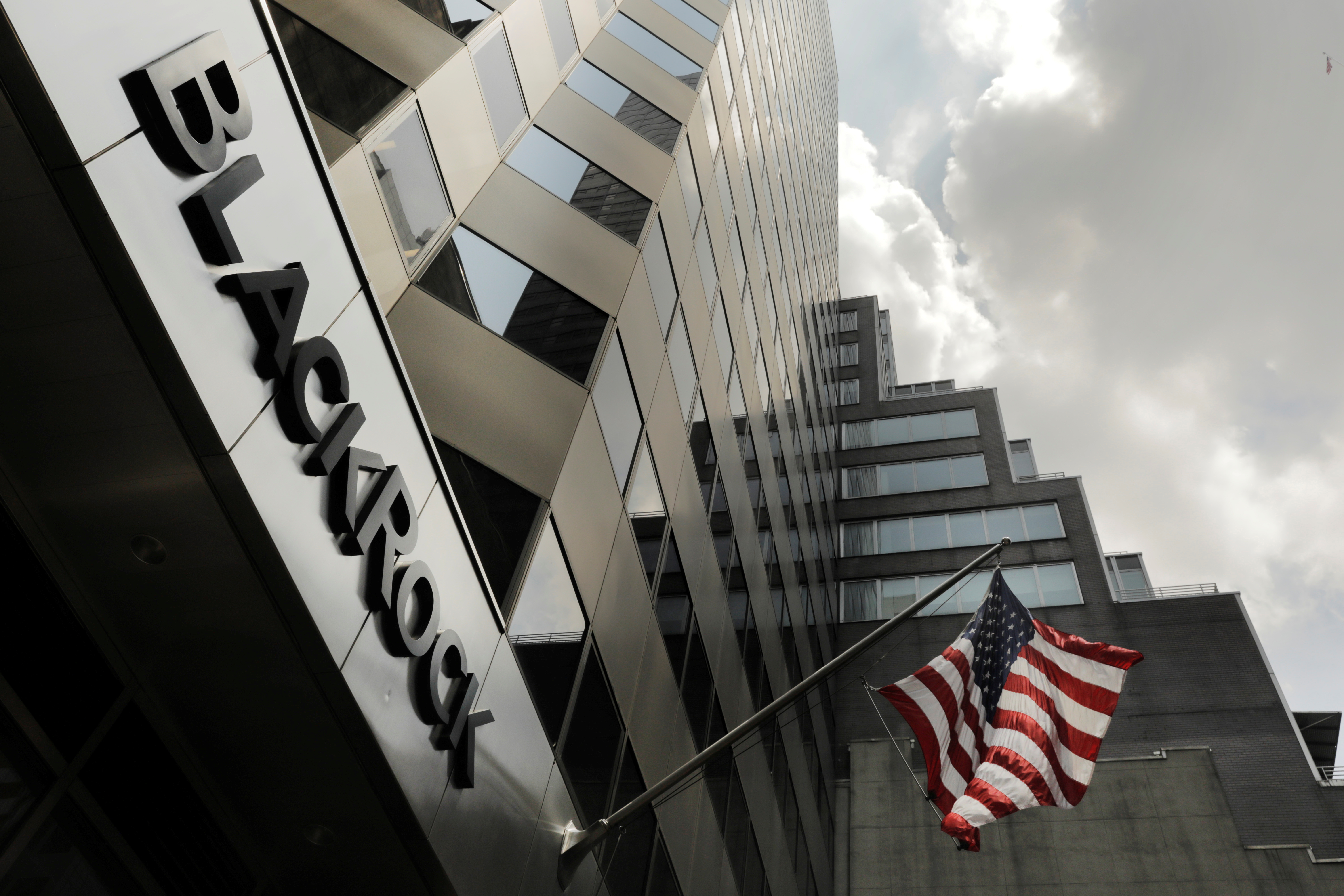 A sign for BlackRock Inc hangs above their building in New York U.S., July 16, 2018. REUTERS/Lucas Jackson/File Photo