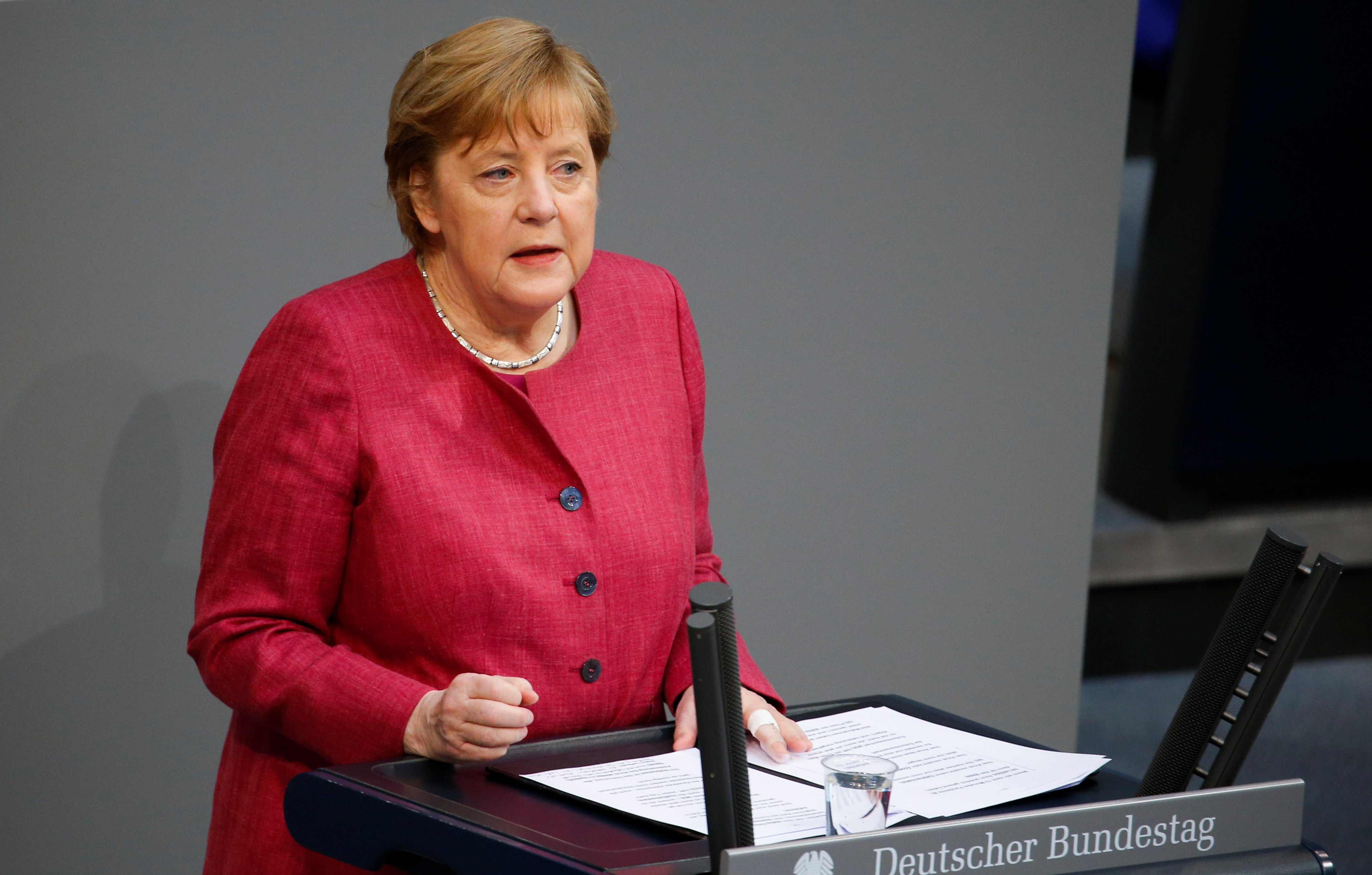 German Chancellor Angela Merkel speaks during a session of the lower house of parliament Bundestag debating the coronavirus disease (COVID-19) measures, in Berlin, Germany, April 16, 2021. REUTERS/Michele Tantussi