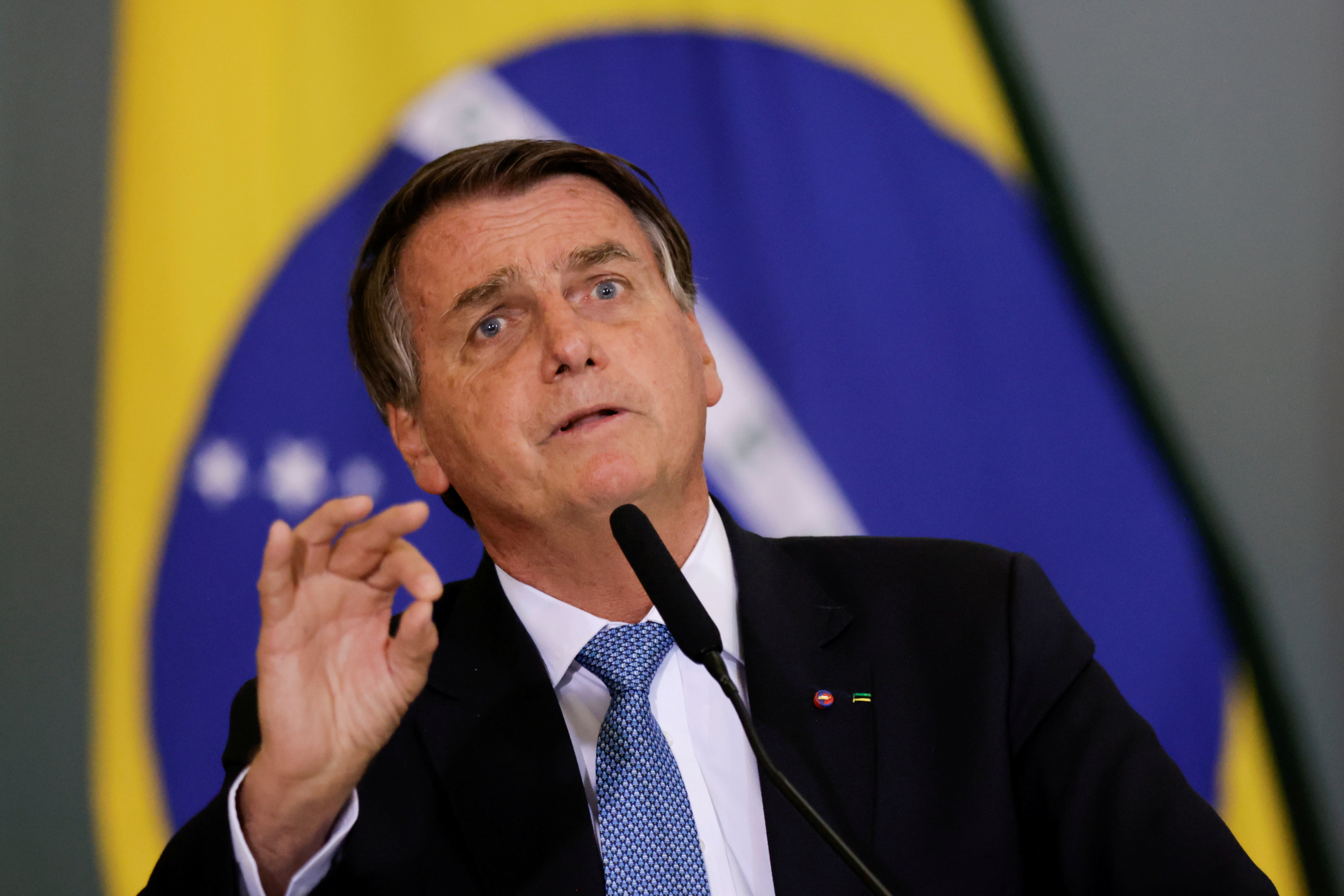 Brazil's President Jair Bolsonaro gestures during the ceremony for the Modernization of Occupational Health and Safety Regulations, at the Planalto Palace in Brasilia, Brazil October 7, 2021. REUTERS/Ueslei Marcelino