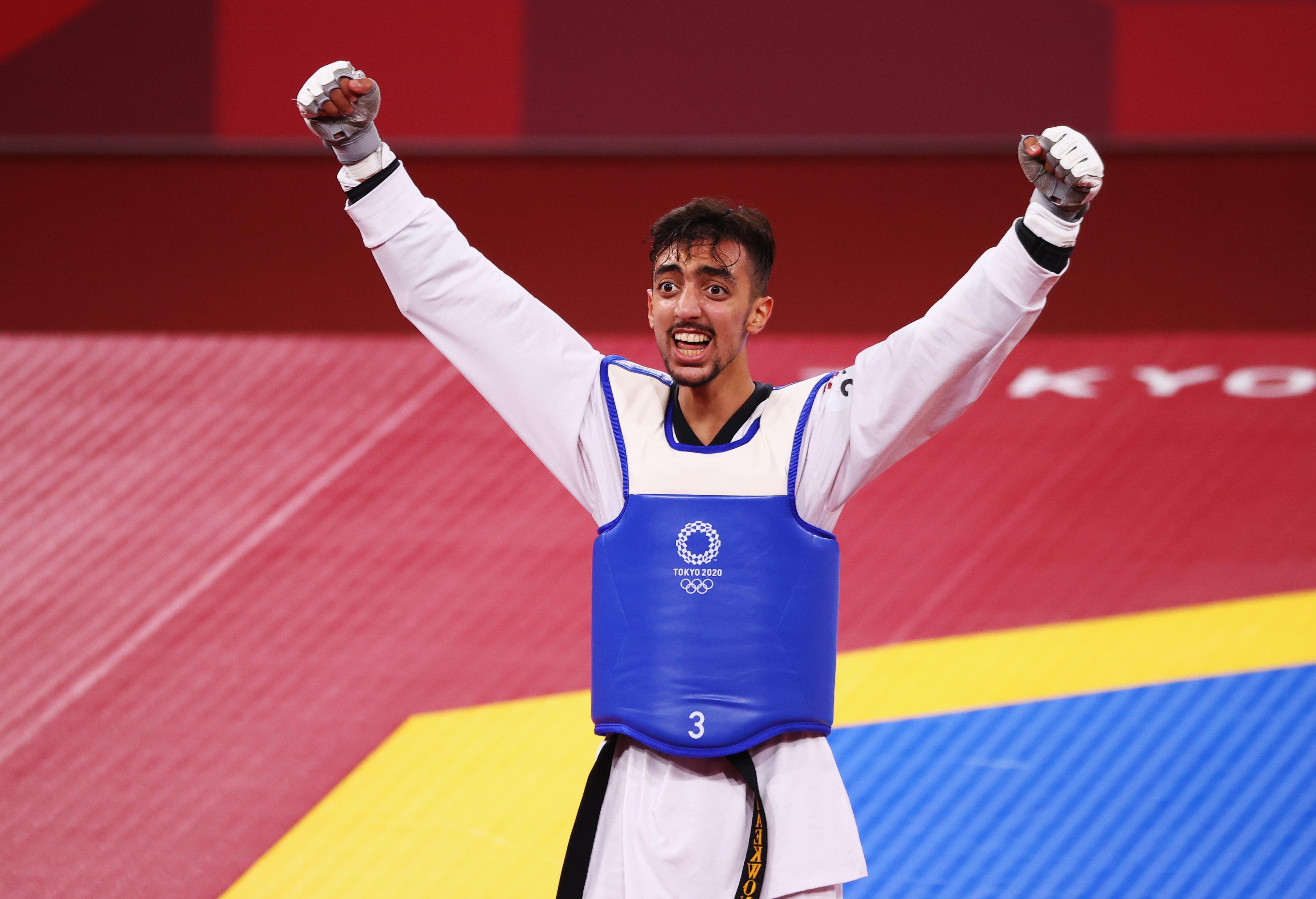 Tokyo 2020 Olympics - Taekwondo - Men's Flyweight - 58kg - Semifinal - Makuhari Messe Hall A, Chiba, Japan - July 24, 2021. Mohamed Khalil Jendoubi of Tunisia celebrates after competing REUTERS/Murad Sezer