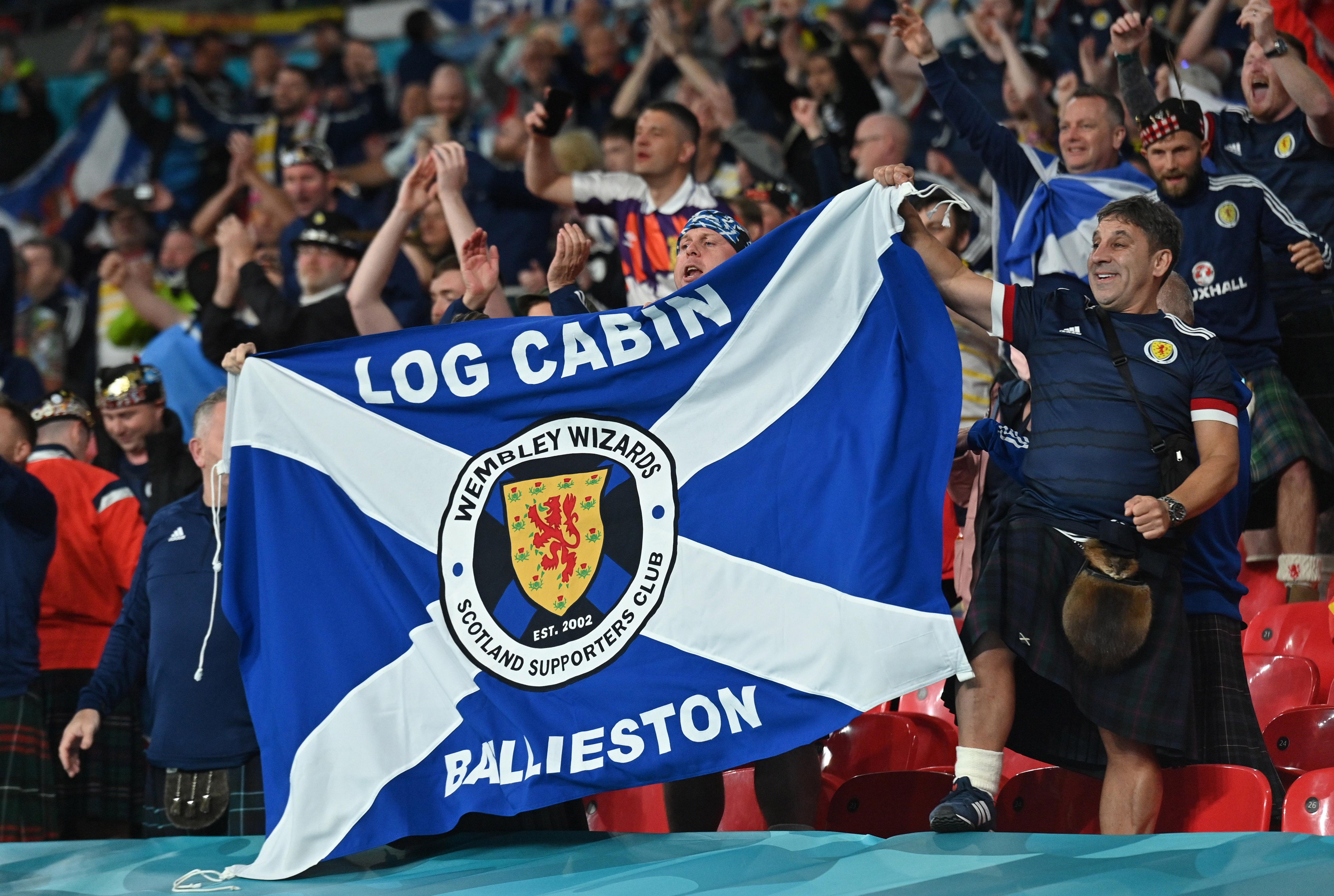 Soccer Football - Euro 2020 - Group D - England v Scotland - Wembley Stadium, London, Britain - June 18, 2021. Scotland fans celebrate after the match Pool via REUTERS/Justin Tallis