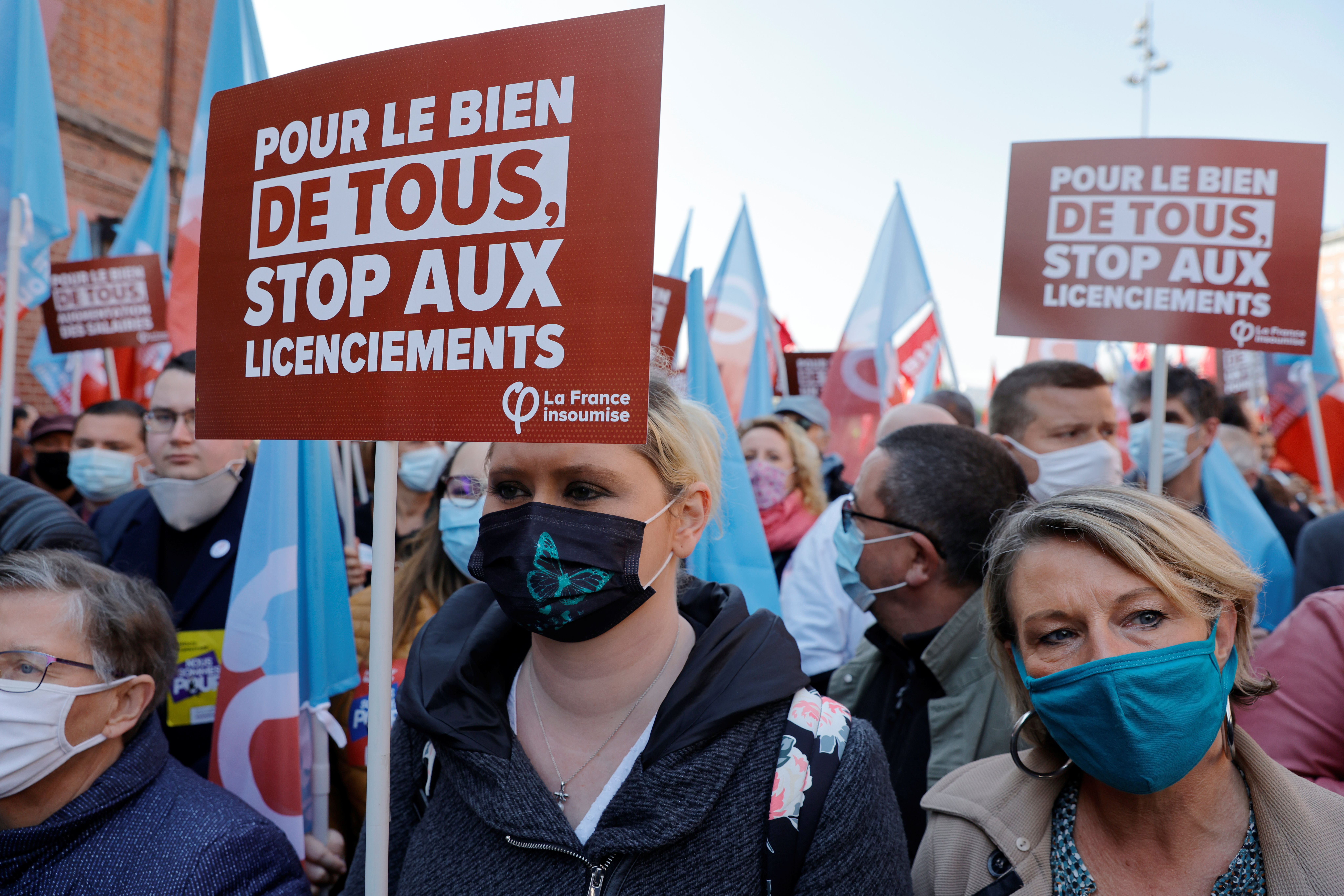 People holding placards attend the traditional May Day labour union march, amid the coronavirus disease (COVID-19) outbreak in Lille, France, May 1, 2021. REUTERS/Pascal Rossignol
