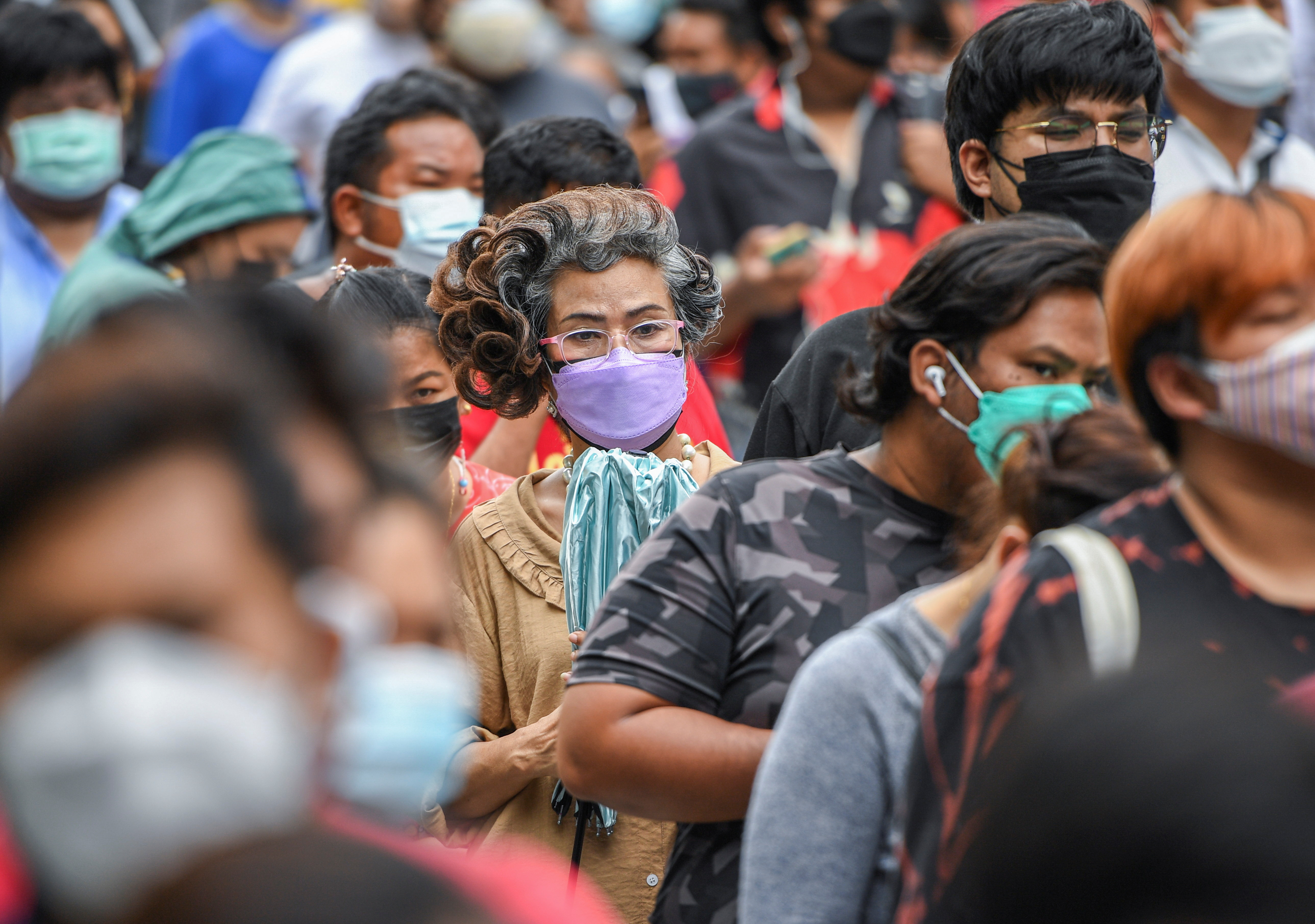 People wearing protective masks queue outside the Central Vaccination Center as Thailand opens walk-in first dose of the AstraZeneca coronavirus disease (COVID-19) vaccination scheme for elders, people with a minimum weight of 100 kilograms and pregnant women amid the COVID-19 outbreak in Bangkok, Thailand, July 22, 2021. REUTERS/Chalinee Thirasupa